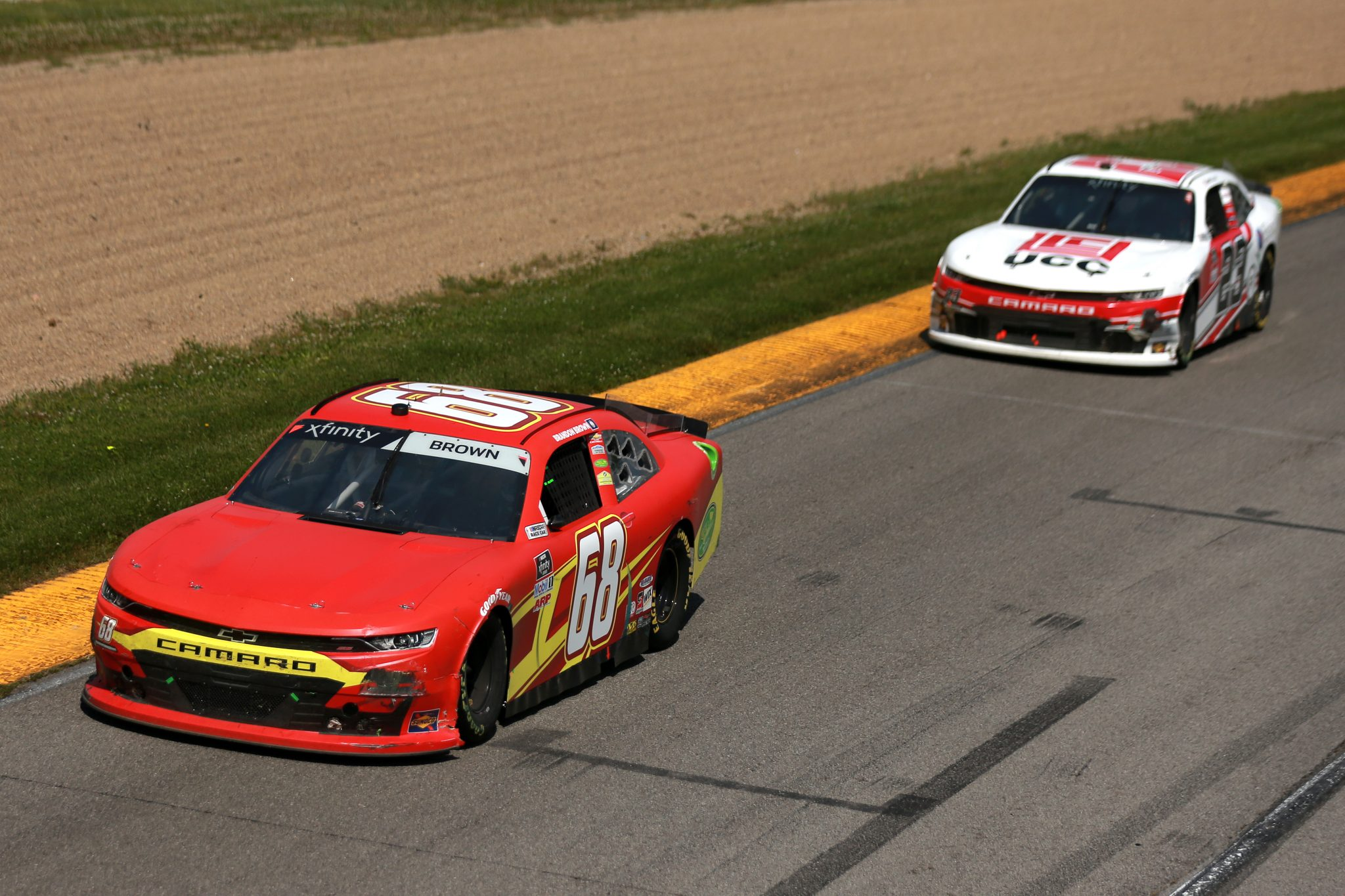 LEXINGTON, OHIO - JUNE 05: Brandon Brown, driver of the #68 Orig. Larry's Hard Lemonade Brewing Co Chevrolet, and Andy Lally, driver of the #23 UCC/Energy Air Inc Chevrolet, race during the NASCAR Xfinity Series B&L Transport 170 at Mid-Ohio Sports Car Course on June 05, 2021 in Lexington, Ohio. (Photo by Sean Gardner/Getty Images) | Getty Images
