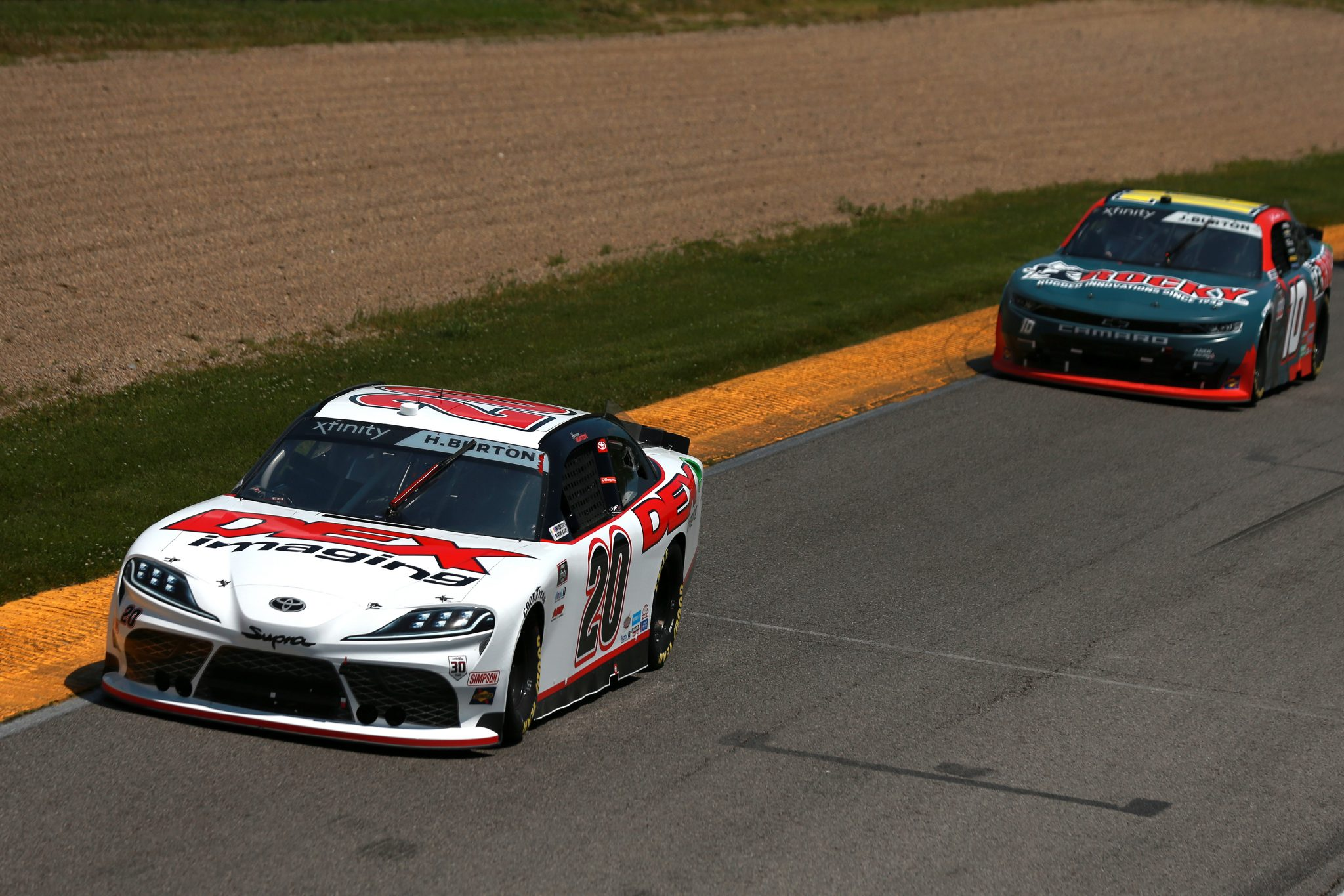 LEXINGTON, OHIO - JUNE 05: Harrison Burton, driver of the #20 DEX Imaging Toyota, and Jeb Burton, driver of the #10 Rocky Boots Chevrolet, race during the NASCAR Xfinity Series B&L Transport 170 at Mid-Ohio Sports Car Course on June 05, 2021 in Lexington, Ohio. (Photo by Sean Gardner/Getty Images) | Getty Images