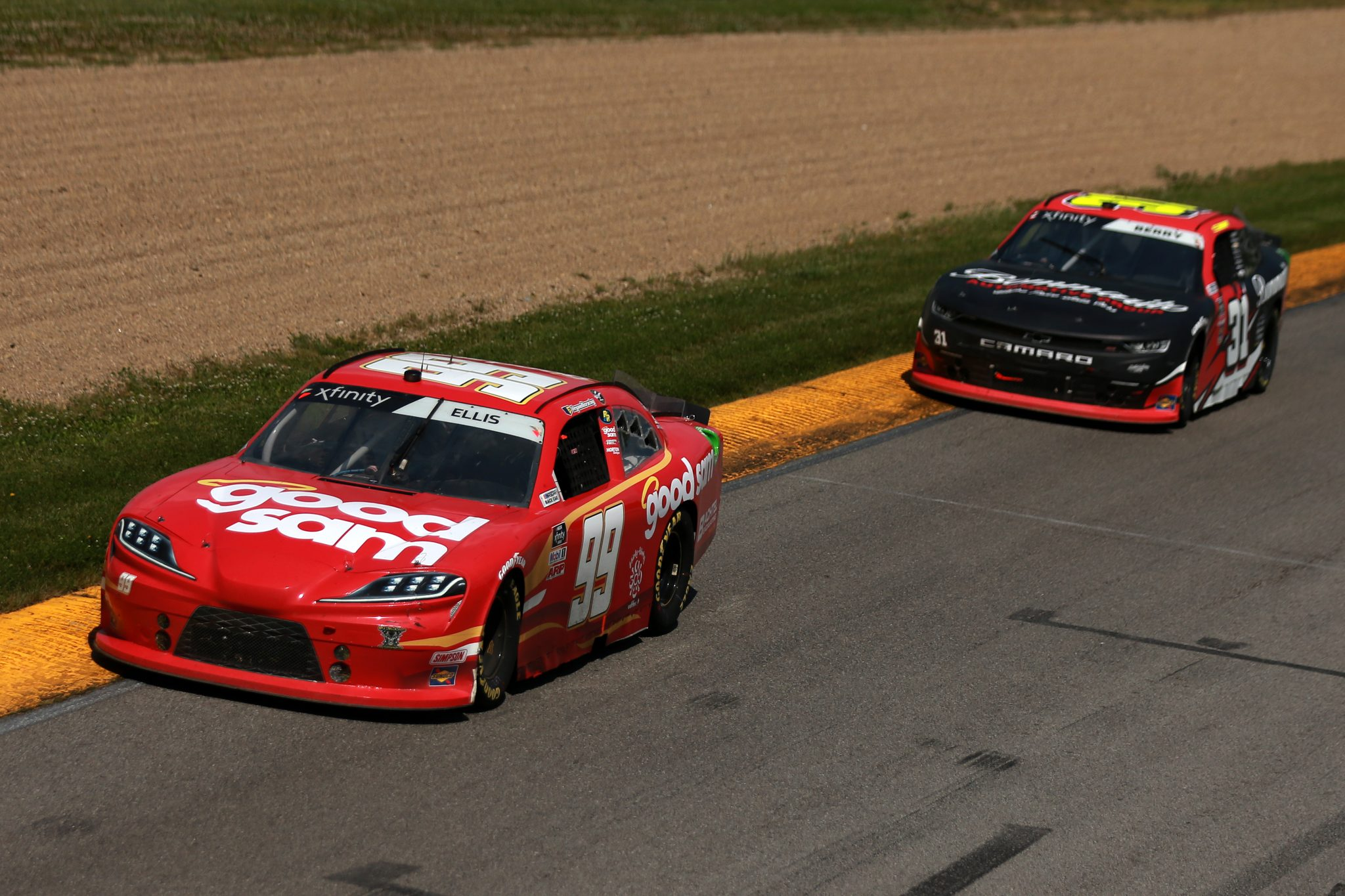 LEXINGTON, OHIO - JUNE 05: Ryan Ellis, driver of the #99 Good Sam/CorvetteParts.net Ford, and Josh Berry, driver of the #31 Bommarito Automotive Group Chevrolet, race during the NASCAR Xfinity Series B&L Transport 170 at Mid-Ohio Sports Car Course on June 05, 2021 in Lexington, Ohio. (Photo by Sean Gardner/Getty Images)   Getty Images
