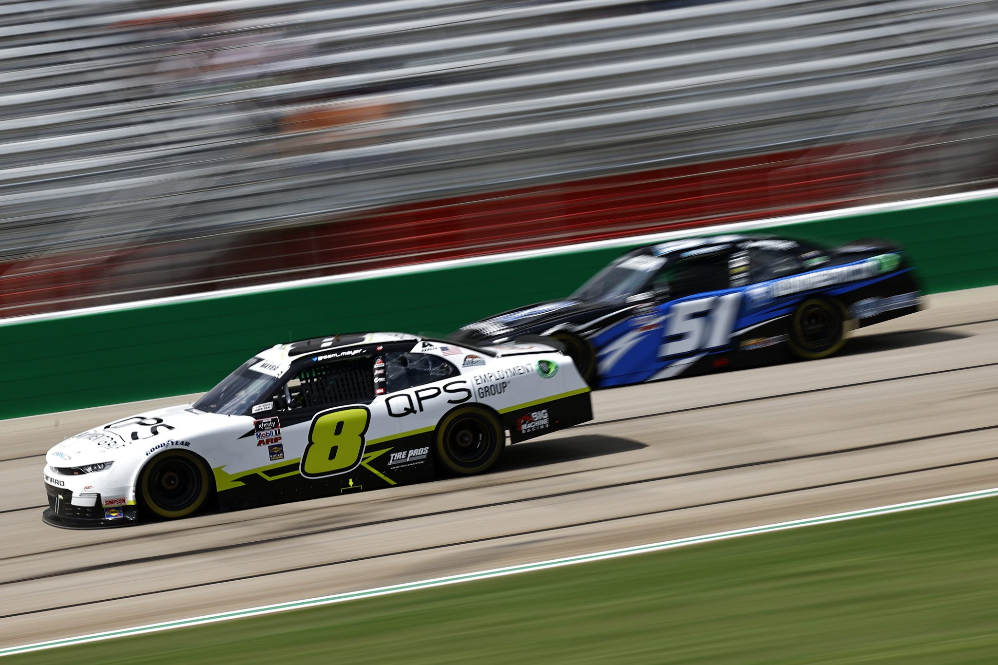 HAMPTON, GEORGIA - JULY 10: Sam Mayer, driver of the #8 QPS Equipment Group Chevrolet, and Jeremy Clements, driver of the #51 All South Electric Chevrolet, race during the NASCAR Xfinity Series Credit Karma Money 250 at Atlanta Motor Speedway on July 10, 2021 in Hampton, Georgia. (Photo by Jared C. Tilton/Getty Images) | Getty Images
