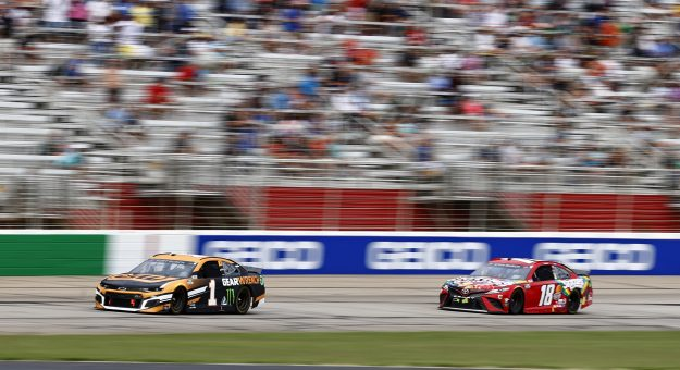 HAMPTON, GEORGIA - JULY 11: Kurt Busch, driver of the #1 GEARWRENCH Chevrolet, leads Kyle Busch, driver of the #18 Skittles Gummies Toyota, on the last lap to win the NASCAR Cup Series Quaker State 400 presented by Walmart at Atlanta Motor Speedway on July 11, 2021 in Hampton, Georgia. (Photo by Jared C. Tilton/Getty Images)   Getty Images