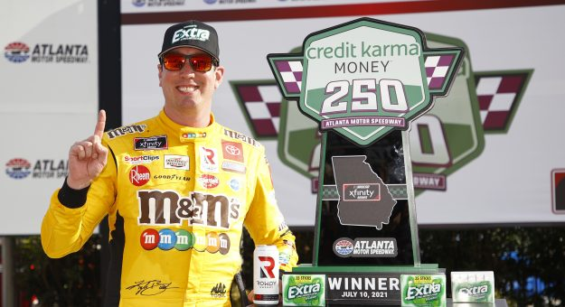 HAMPTON, GEORGIA - JULY 10: Kyle Busch, driver of the #54 Extra Gum Toyota, celebrates in victory lane after winning the NASCAR Xfinity Series Credit Karma Money 250 at Atlanta Motor Speedway on July 10, 2021 in Hampton, Georgia. (Photo by Jared C. Tilton/Getty Images)   Getty Images