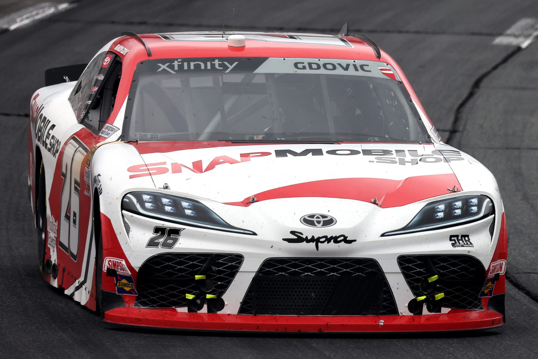 LOUDON, NEW HAMPSHIRE - JULY 17: Brandon Gdovic, driver of the #26 SnapMobile.Shop Toyota, drives during the NASCAR Xfinity Series Ambetter Get Vaccinated 200 at New Hampshire Motor Speedway on July 17, 2021 in Loudon, New Hampshire. (Photo by James Gilbert/Getty Images) | Getty Images