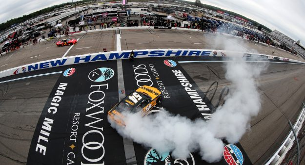 LOUDON, NEW HAMPSHIRE - JULY 17: Christopher Bell, driver of the #54 DEWALT Toyota,celebrates with a burnout after winning the NASCAR Xfinity Series Ambetter Get Vaccinated 200 at New Hampshire Motor Speedway on July 17, 2021 in Loudon, New Hampshire. (Photo by James Gilbert/Getty Images)   Getty Images