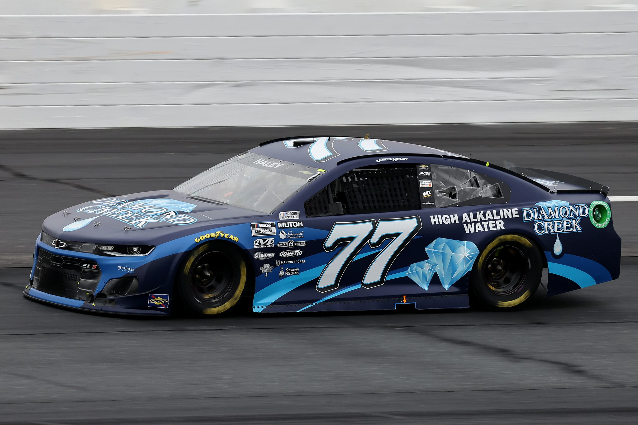 LOUDON, NEW HAMPSHIRE - JULY 18: Justin Haley, driver of the #77 Diamond Creek Water Chevrolet, drives during the NASCAR Cup Series Foxwoods Resort Casino 301 at New Hampshire Motor Speedway on July 18, 2021 in Loudon, New Hampshire. (Photo by James Gilbert/Getty Images) | Getty Images