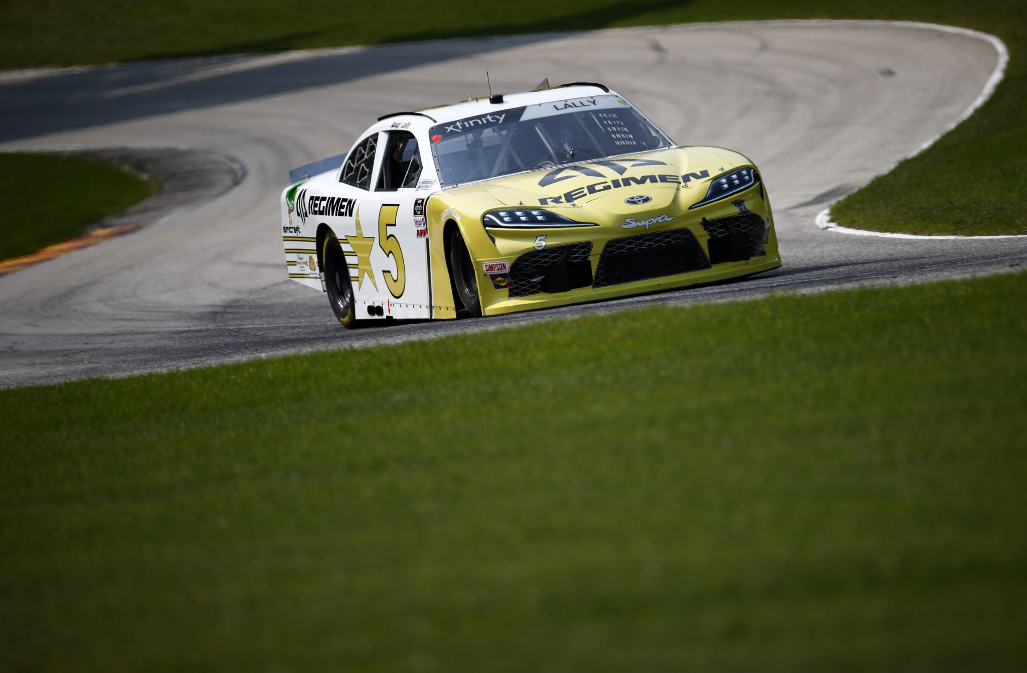 ELKHART LAKE, WISCONSIN - JULY 02: Andy Lally, driver of the #5 Alpha Prime Regimen Toyota, drives during practice for the NASCAR Xfinity Series Henry 180 at Road America on July 02, 2021 in Elkhart Lake, Wisconsin. (Photo by Jared C. Tilton/Getty Images) | Getty Images