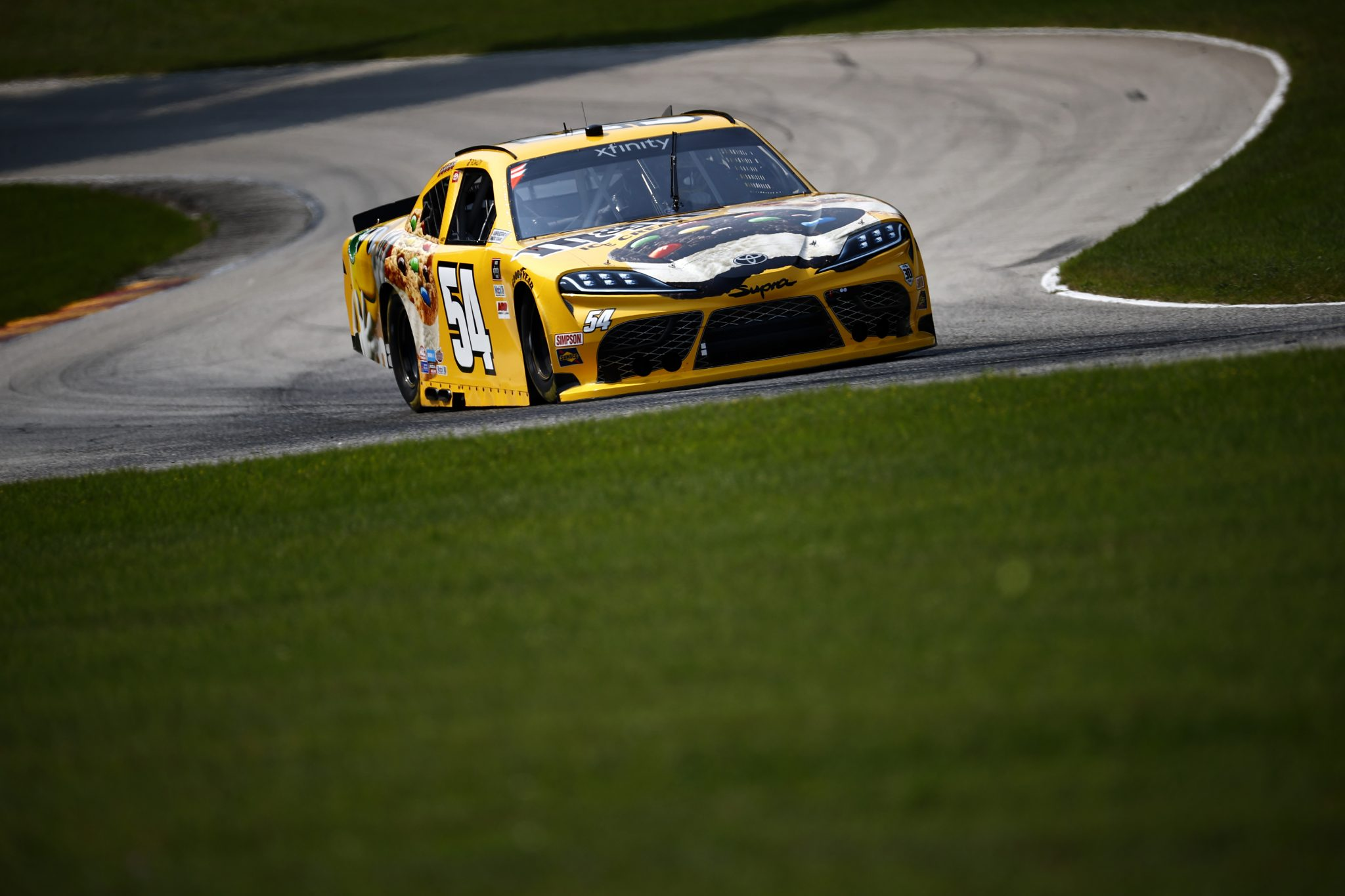 ELKHART LAKE, WISCONSIN - JULY 02: Kyle Busch, driver of the #54 M&M's Ice Cream Toyota, drives during practice for the NASCAR Xfinity Series Henry 180 at Road America on July 02, 2021 in Elkhart Lake, Wisconsin. (Photo by Jared C. Tilton/Getty Images) | Getty Images