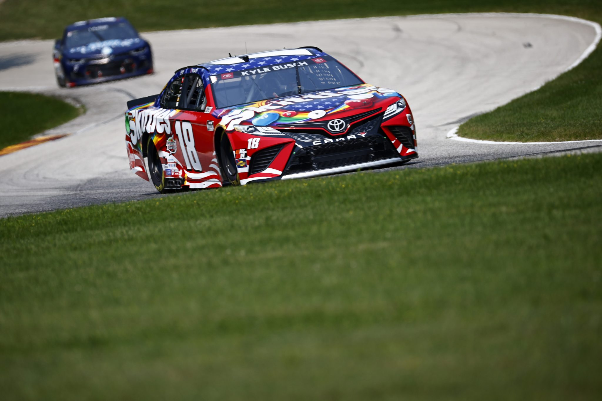 ELKHART LAKE, WISCONSIN - JULY 03: Kyle Busch, driver of the #18 Skittles Red White & Blue Toyota, during practice for the NASCAR Cup Series Jockey Made in America 250 Presented by Kwik Trip at Road America on July 03, 2021 in Elkhart Lake, Wisconsin. (Photo by Jared C. Tilton/Getty Images) | Getty Images