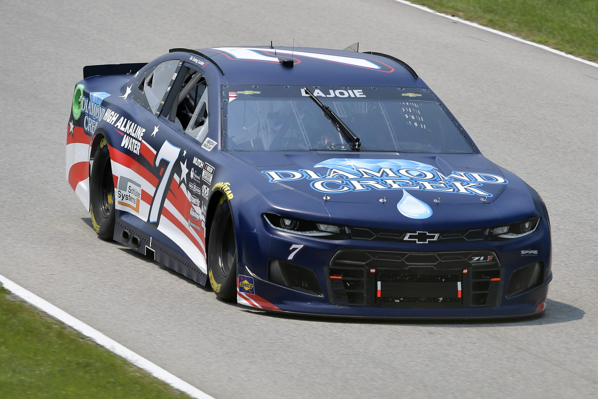 ELKHART LAKE, WISCONSIN - JULY 03: Corey LaJoie, driver of the #7 Diamond Creek Water Chevrolet, drives during practice for the NASCAR Cup Series Jockey Made in America 250 Presented by Kwik Trip at Road America on July 03, 2021 in Elkhart Lake, Wisconsin. (Photo by Logan Riely/Getty Images)   Getty Images