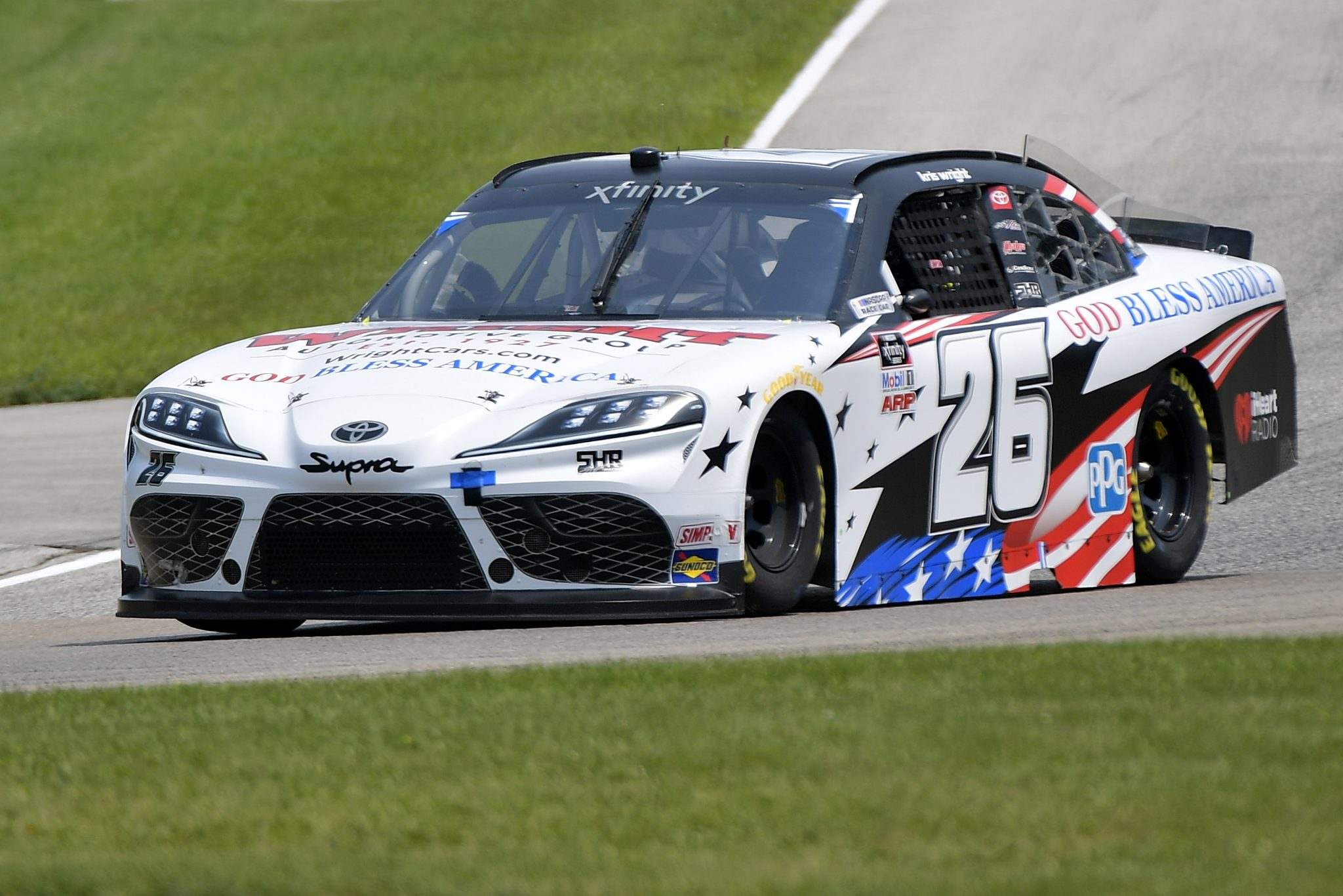 ELKHART LAKE, WISCONSIN - JULY 03: Kris Wright, driver of the #26 Wright Automotive Toyota, drives during the NASCAR Xfinity Series Henry 180 at Road America on July 03, 2021 in Elkhart Lake, Wisconsin. (Photo by Logan Riely/Getty Images) | Getty Images