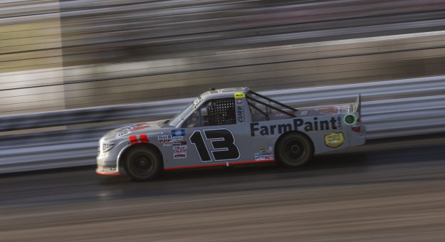 KNOXVILLE, IOWA - JULY 08: Johnny Sauter, driver of the #13 FarmPaint.com Toyota, drives during practice for the NASCAR Camping World Truck Series Corn Belt 150 presented by Premier Chevy Dealers at Knoxville Raceway on July 08, 2021 in Knoxville, Iowa. (Photo by James Gilbert/Getty Images) | Getty Images
