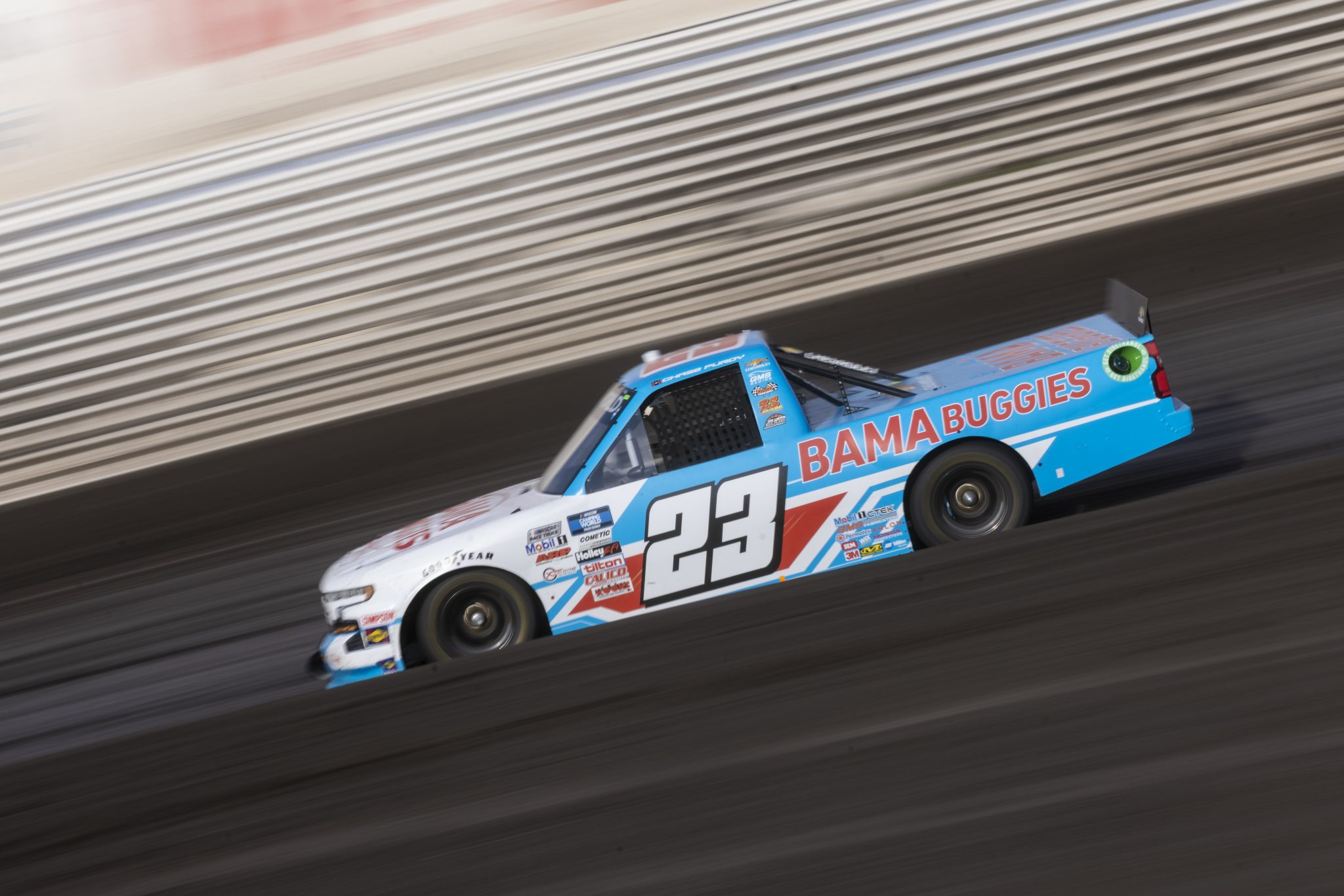 KNOXVILLE, IOWA - JULY 08: Chase Purdy, driver of the #23 BamaBuggies.com Chevrolet, drives during practice for the NASCAR Camping World Truck Series Corn Belt 150 presented by Premier Chevy Dealers at Knoxville Raceway on July 08, 2021 in Knoxville, Iowa. (Photo by James Gilbert/Getty Images)   Getty Images