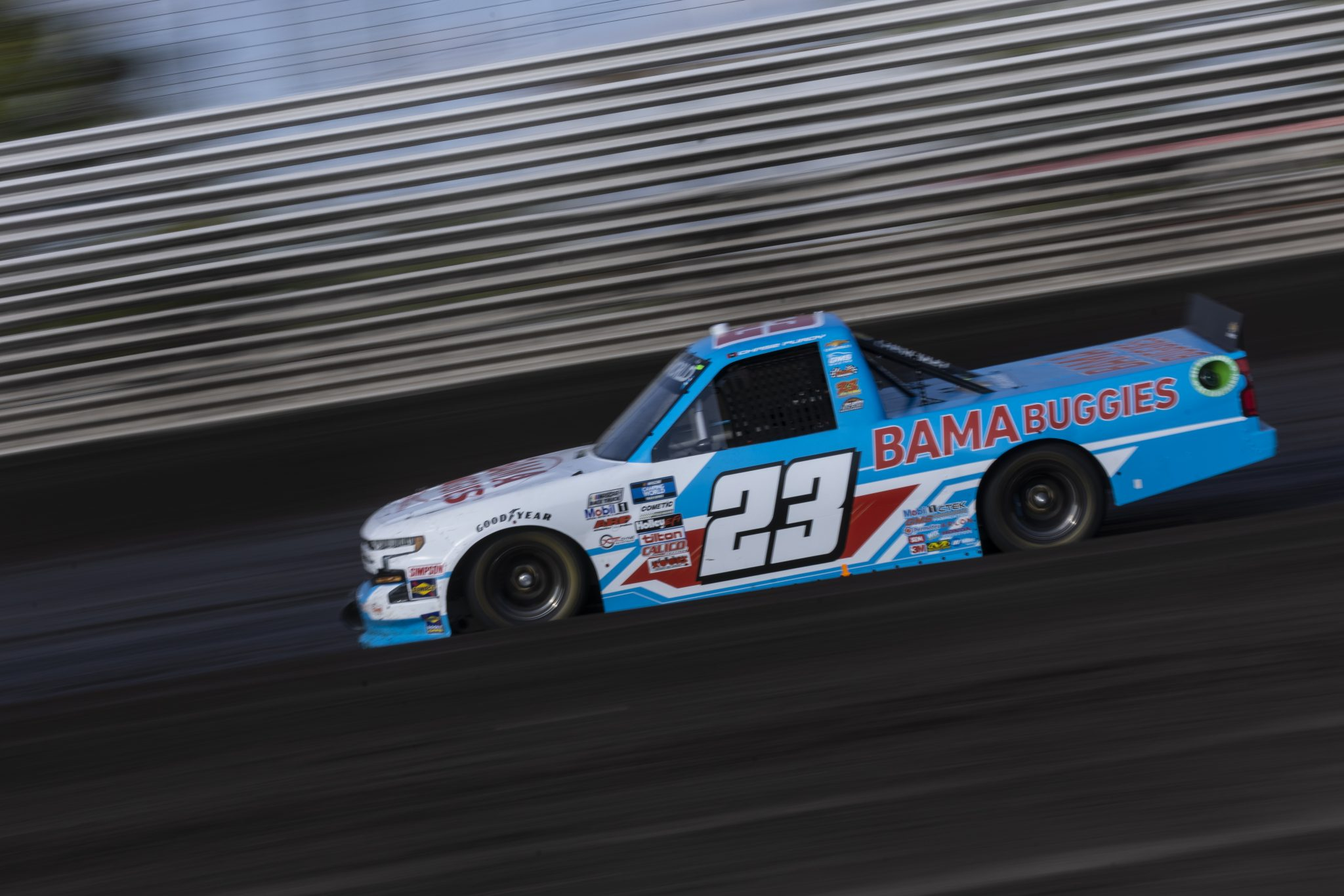 KNOXVILLE, IOWA - JULY 08: Chase Purdy, driver of the #23 BamaBuggies.com Chevrolet, drives during practice for the NASCAR Camping World Truck Series Corn Belt 150 presented by Premier Chevy Dealers at Knoxville Raceway on July 08, 2021 in Knoxville, Iowa. (Photo by James Gilbert/Getty Images) | Getty Images