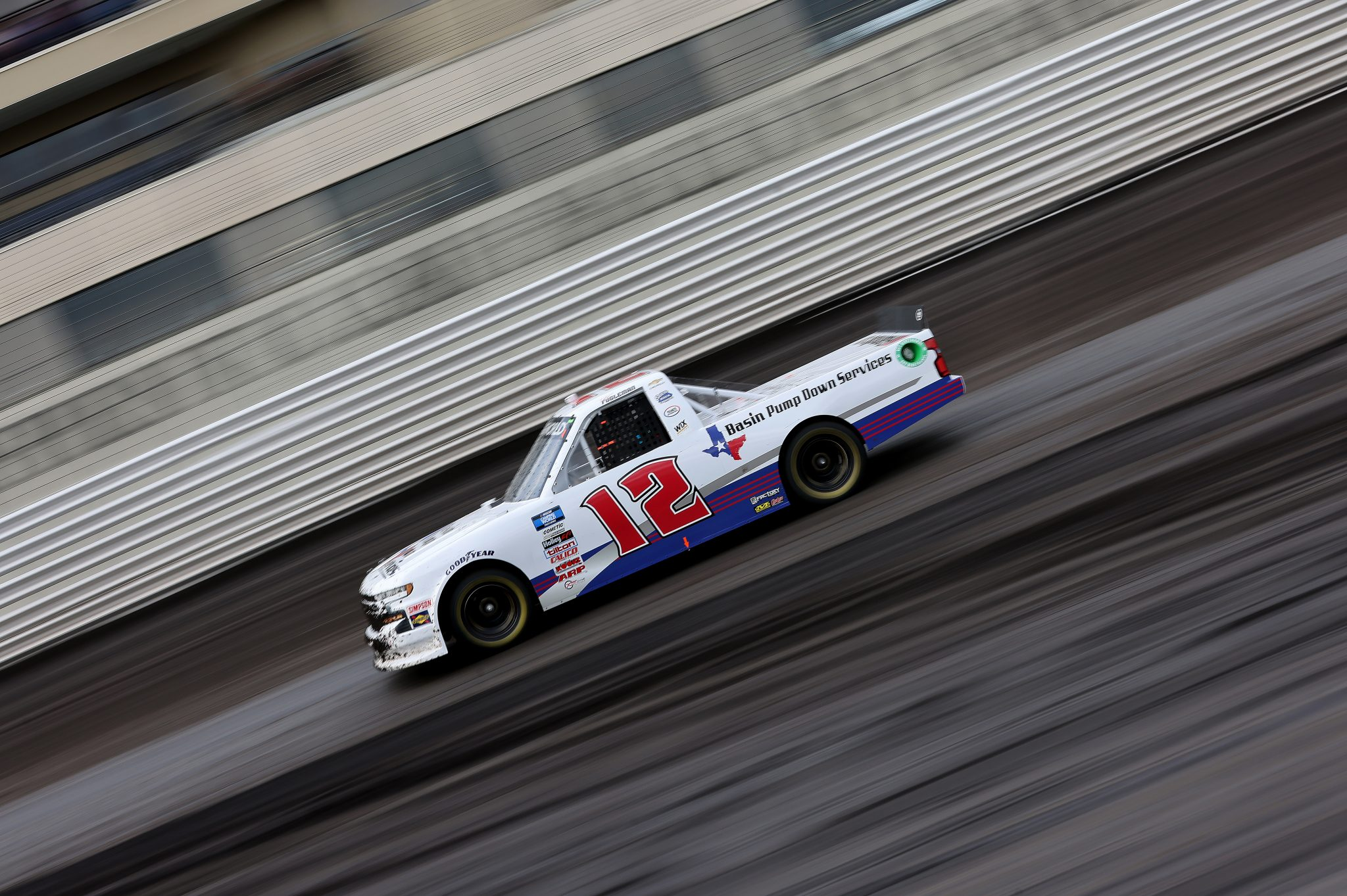 KNOXVILLE, IOWA - JULY 09: Tate Fogleman, driver of the #12 Basin Pump Down Services Chevrolet, drives during qualifying for the NASCAR Camping World Truck Series Corn Belt 150 presented by Premier Chevy Dealers at Knoxville Raceway on July 09, 2021 in Knoxville, Iowa. (Photo by James Gilbert/Getty Images) | Getty Images