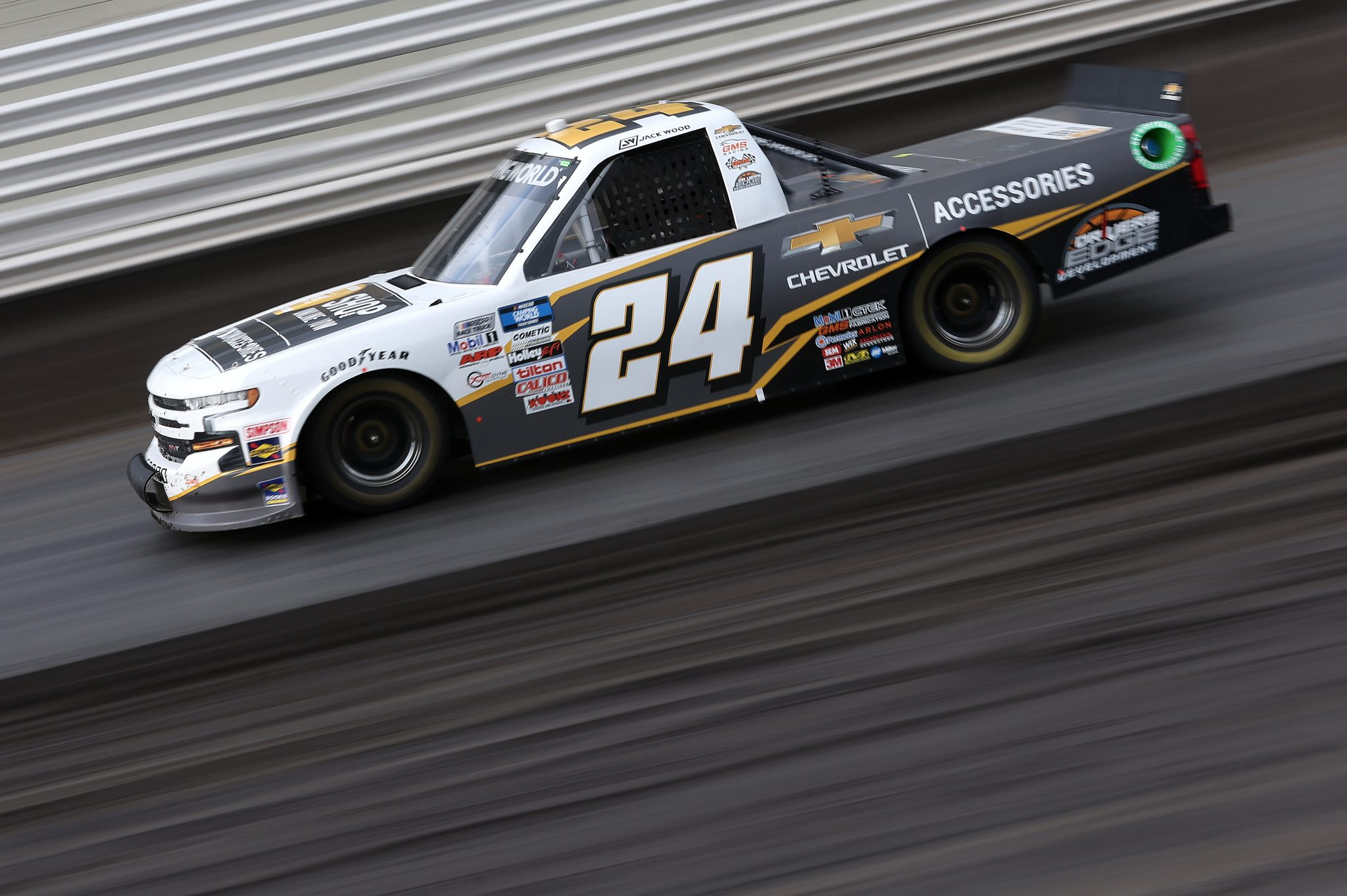 KNOXVILLE, IOWA - JULY 09: Jack Wood, driver of the #24 Chevy Accessories Chevrolet, drives during qualifying for the NASCAR Camping World Truck Series Corn Belt 150 presented by Premier Chevy Dealers at Knoxville Raceway on July 09, 2021 in Knoxville, Iowa. (Photo by James Gilbert/Getty Images) | Getty Images
