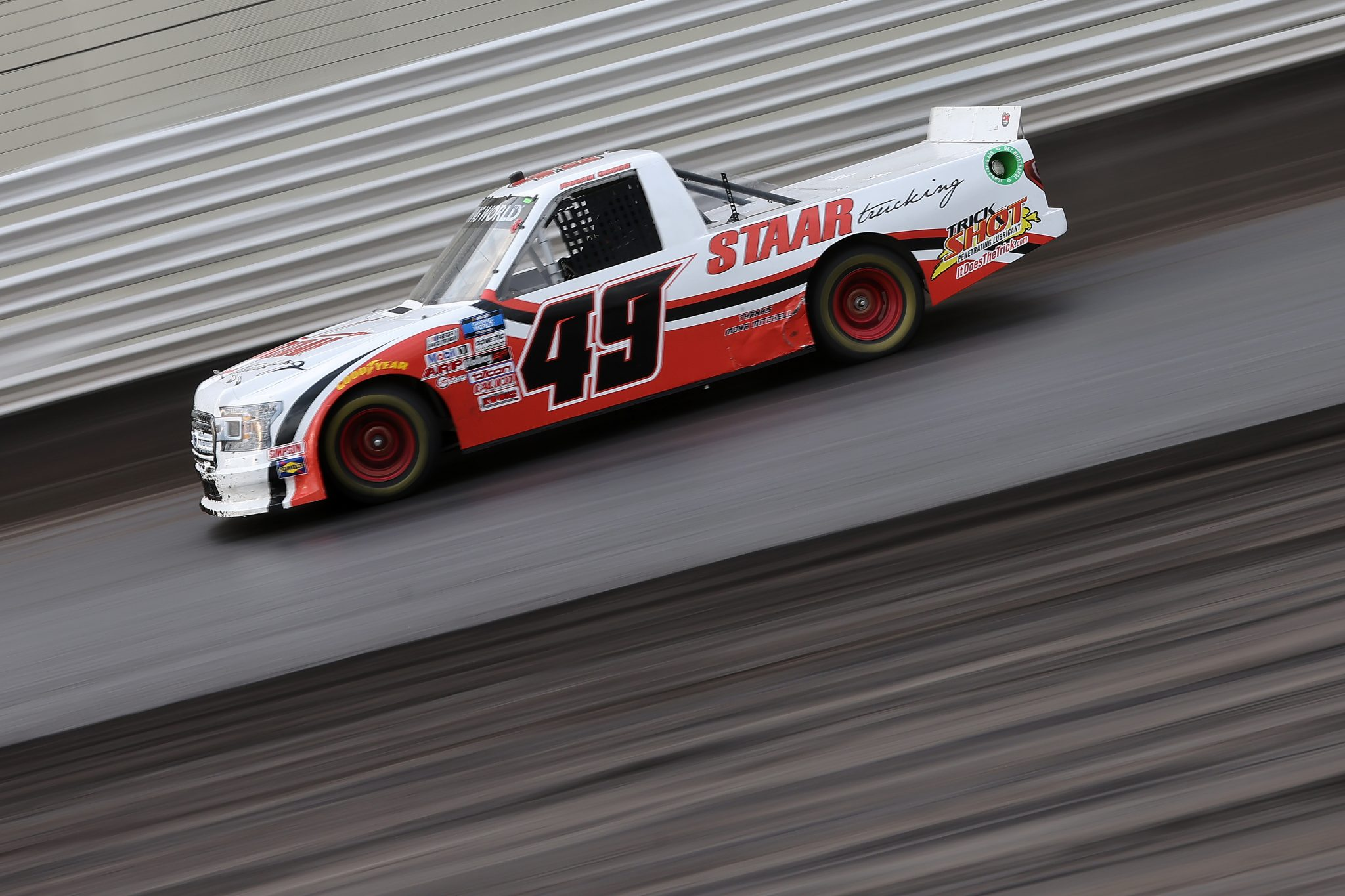 KNOXVILLE, IOWA - JULY 09: Andrew Gordon, driver of the #49 Staar Trucking Toyota, drives during qualifying for the NASCAR Camping World Truck Series Corn Belt 150 presented by Premier Chevy Dealers at Knoxville Raceway on July 09, 2021 in Knoxville, Iowa. (Photo by James Gilbert/Getty Images) | Getty Images
