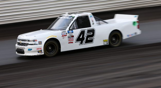 KNOXVILLE, IOWA - JULY 09: Carson Hocevar, driver of the #42 Premier Security Chevrolet, drives during qualifying for the NASCAR Camping World Truck Series Corn Belt 150 presented by Premier Chevy Dealers at Knoxville Raceway on July 09, 2021 in Knoxville, Iowa. (Photo by James Gilbert/Getty Images) | Getty Images