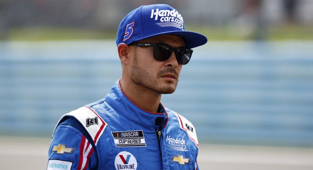 WATKINS GLEN, NEW YORK - AUGUST 08: Kyle Larson, driver of the #5 HendrickCars.com Chevrolet, waits on the grid prior to the NASCAR Cup Series Go Bowling at The Glen at Watkins Glen International on August 08, 2021 in Watkins Glen, New York. (Photo by Jared C. Tilton/Getty Images) | Getty Images
