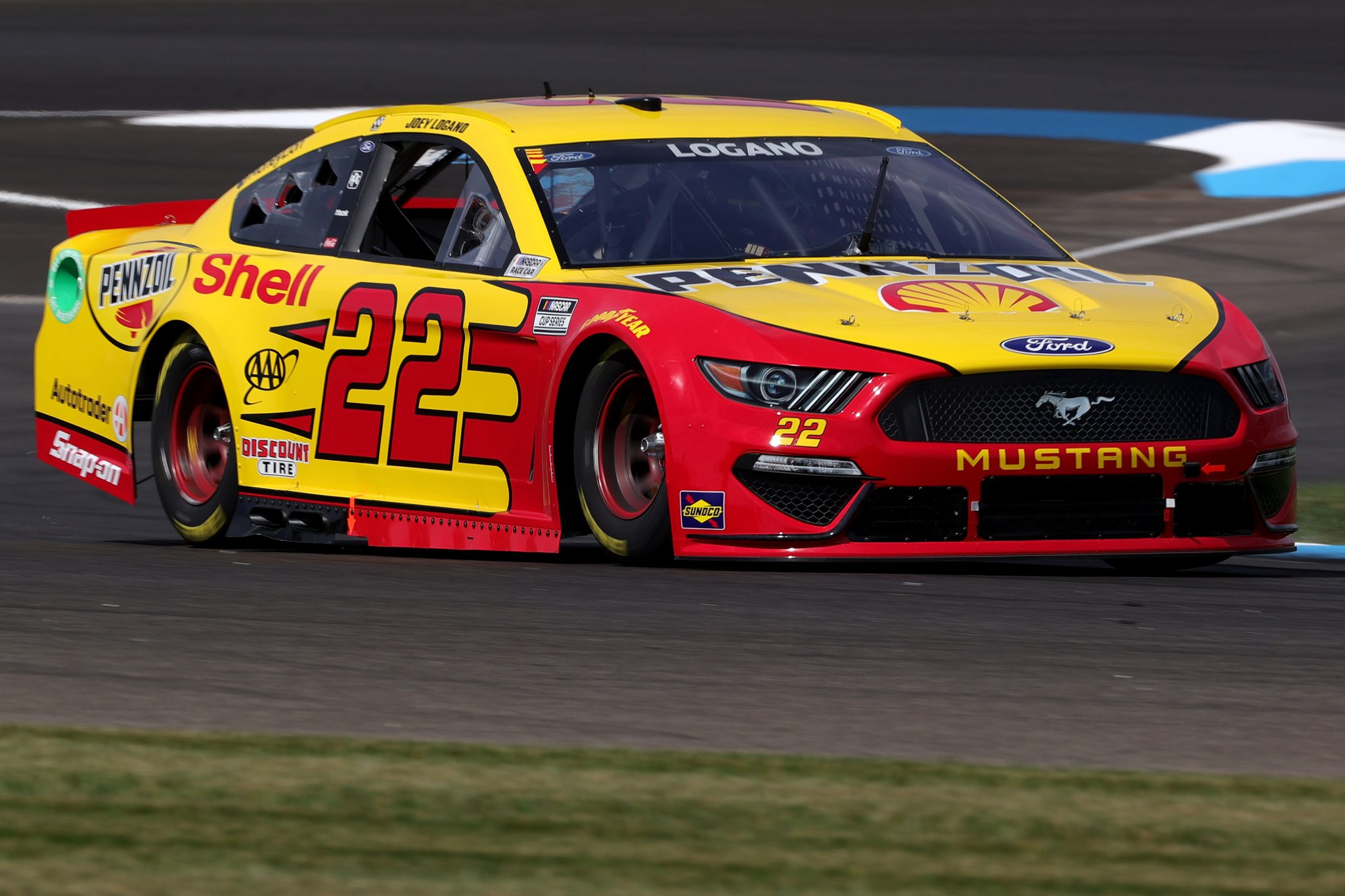 INDIANAPOLIS, INDIANA - AUGUST 14: Joey Logano, driver of the #22 Shell Pennzoil Ford, drives during practice for the NASCAR Cup Series Verizon 200 at the Brickyard at Indianapolis Motor Speedway on August 14, 2021 in Indianapolis, Indiana. (Photo by Stacy Revere/Getty Images)   Getty Images