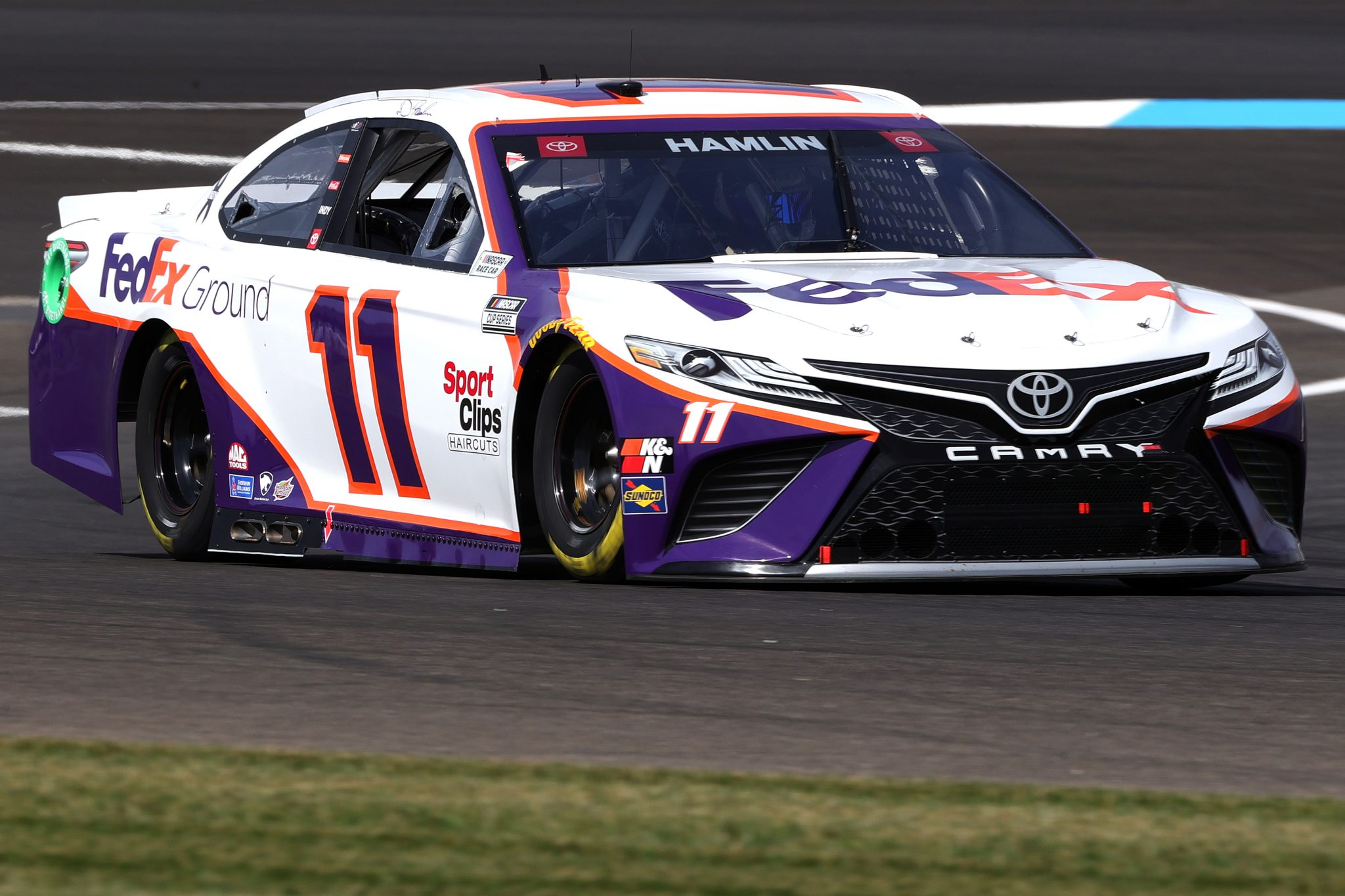 INDIANAPOLIS, INDIANA - AUGUST 14: Denny Hamlin, driver of the #11 FedEx Ground Toyota, drives during practice for the NASCAR Cup Series Verizon 200 at the Brickyard at Indianapolis Motor Speedway on August 14, 2021 in Indianapolis, Indiana. (Photo by Stacy Revere/Getty Images)   Getty Images