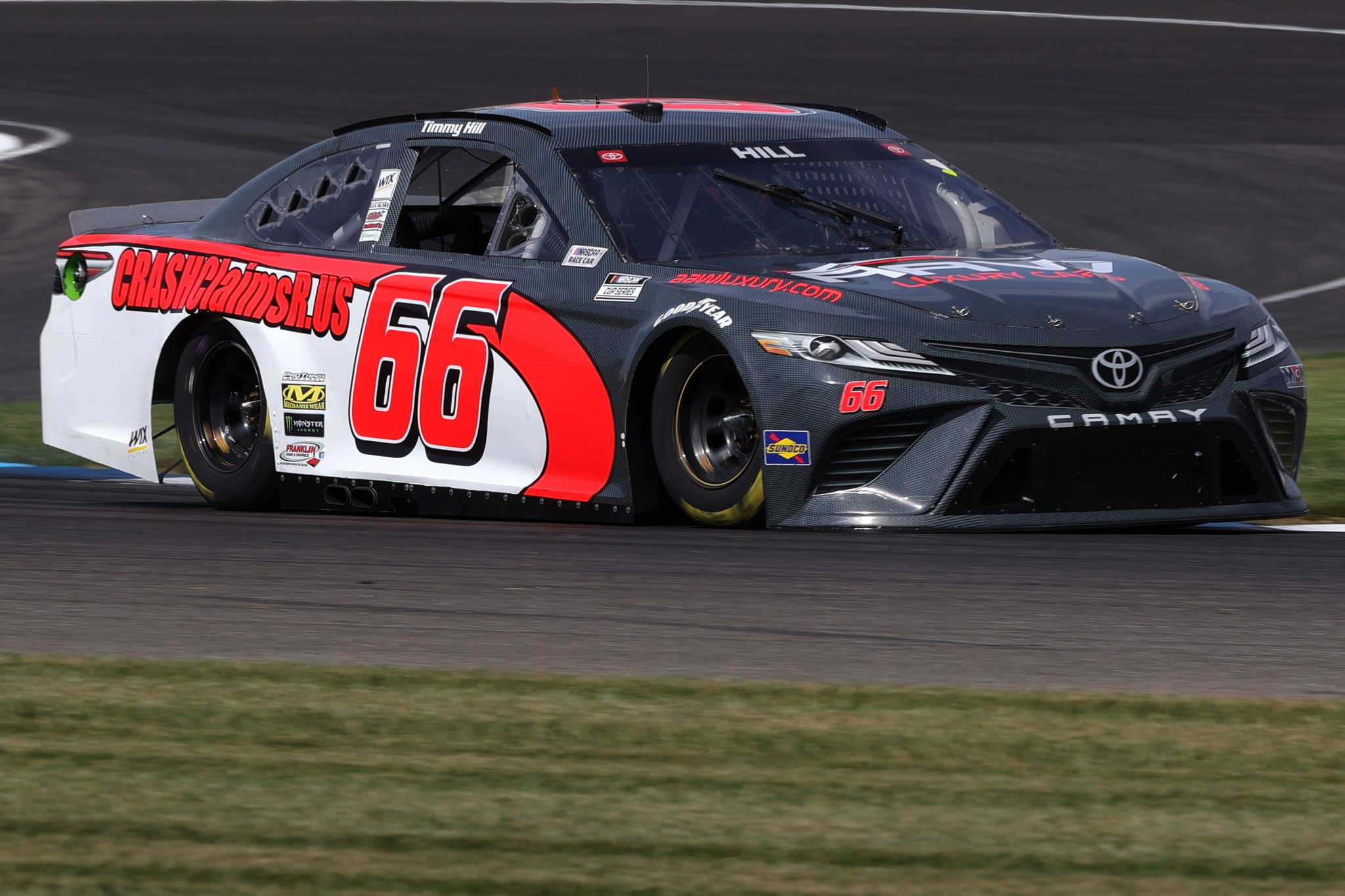 INDIANAPOLIS, INDIANA - AUGUST 14: Timmy Hill, driver of the #66 AAW Luxury Cars/CrashClaims Toyota, drives during practice for the NASCAR Cup Series Verizon 200 at the Brickyard at Indianapolis Motor Speedway on August 14, 2021 in Indianapolis, Indiana. (Photo by Stacy Revere/Getty Images) | Getty Images