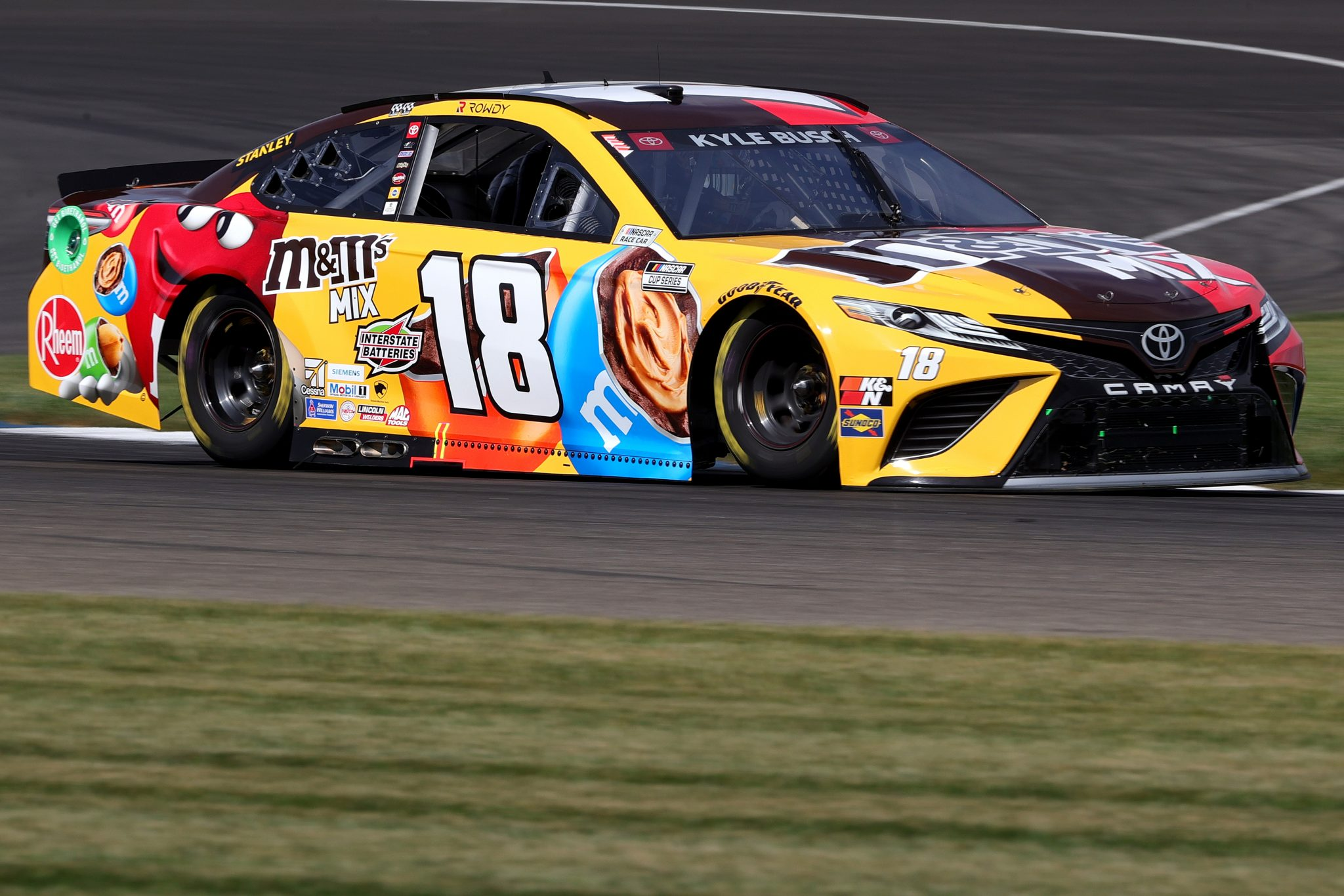 INDIANAPOLIS, INDIANA - AUGUST 14: Kyle Busch, driver of the #18 M&M's Mix Toyota, drives during practice for the NASCAR Cup Series Verizon 200 at the Brickyard at Indianapolis Motor Speedway on August 14, 2021 in Indianapolis, Indiana. (Photo by Stacy Revere/Getty Images) | Getty Images