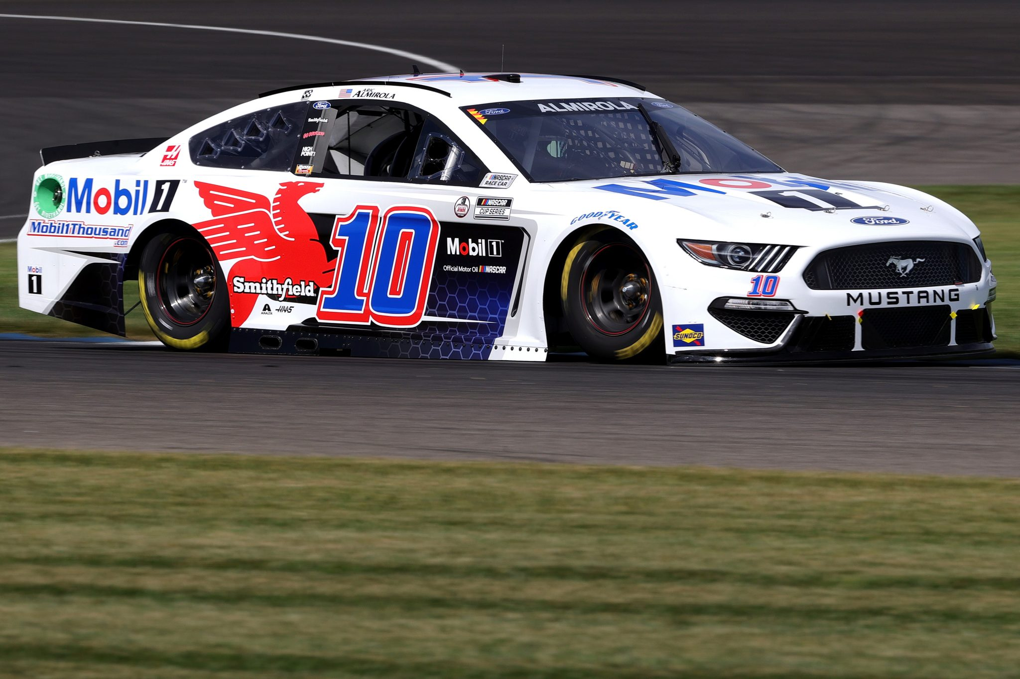 INDIANAPOLIS, INDIANA - AUGUST 14: Aric Almirola, driver of the #10 Mobil 1 Ford, drives during practice for the NASCAR Cup Series Verizon 200 at the Brickyard at Indianapolis Motor Speedway on August 14, 2021 in Indianapolis, Indiana. (Photo by Stacy Revere/Getty Images)   Getty Images