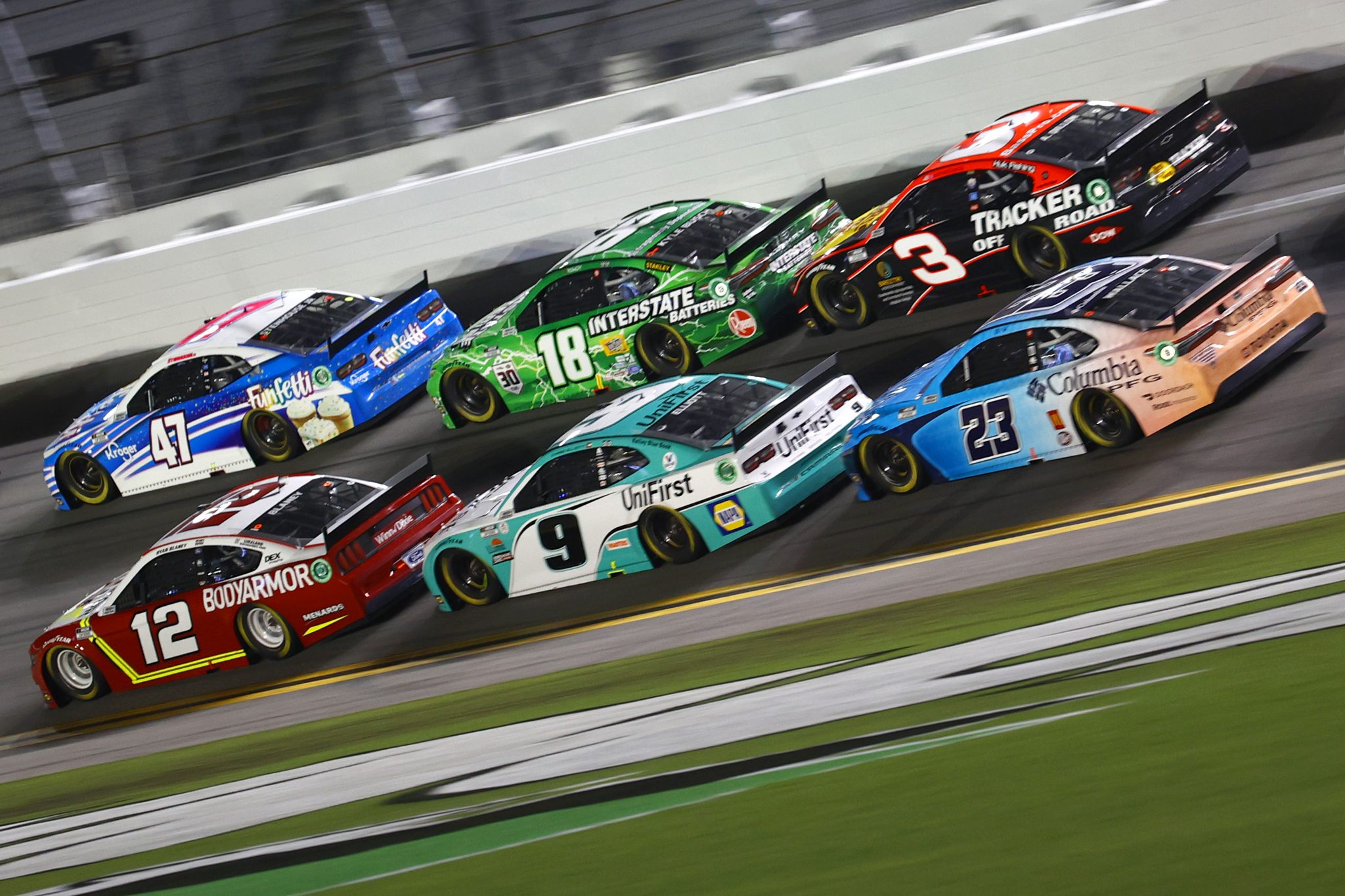 DAYTONA BEACH, FLORIDA - AUGUST 28: Ryan Blaney, driver of the #12 BodyArmor Ford, Ricky Stenhouse Jr., driver of the #47 Funfetti Chevrolet, Kyle Busch, driver of the #18 Interstate Batteries Toyota, Chase Elliott, driver of the #9 UniFirst Chevrolet, Austin Dillon, driver of the #3 Bass Pro Shops/Tracker Off Road Chevrolet, and Bubba Wallace, driver of the #23 Columbia PFG Toyota, race during the NASCAR Cup Series Coke Zero Sugar 400 at Daytona International Speedway on August 28, 2021 in Daytona Beach, Florida. (Photo by Jared C. Tilton/Getty Images) | Getty Images