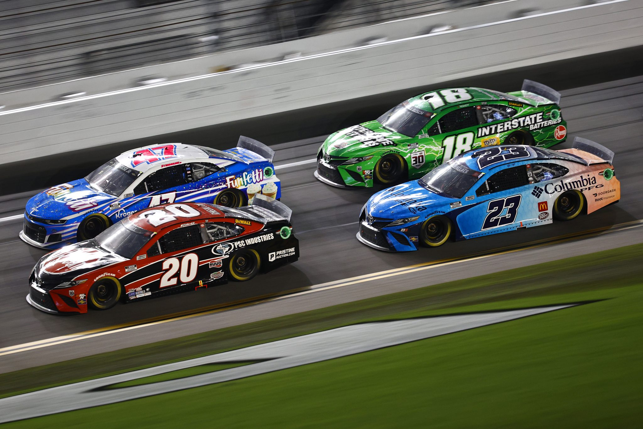DAYTONA BEACH, FLORIDA - AUGUST 28: Christopher Bell, driver of the #20 Rheem Toyota, Ricky Stenhouse Jr., driver of the #47 Funfetti Chevrolet, Bubba Wallace, driver of the #23 Columbia PFG Toyota, and Kyle Busch, driver of the #18 Interstate Batteries Toyota, race during the NASCAR Cup Series Coke Zero Sugar 400 at Daytona International Speedway on August 28, 2021 in Daytona Beach, Florida. (Photo by Jared C. Tilton/Getty Images) | Getty Images