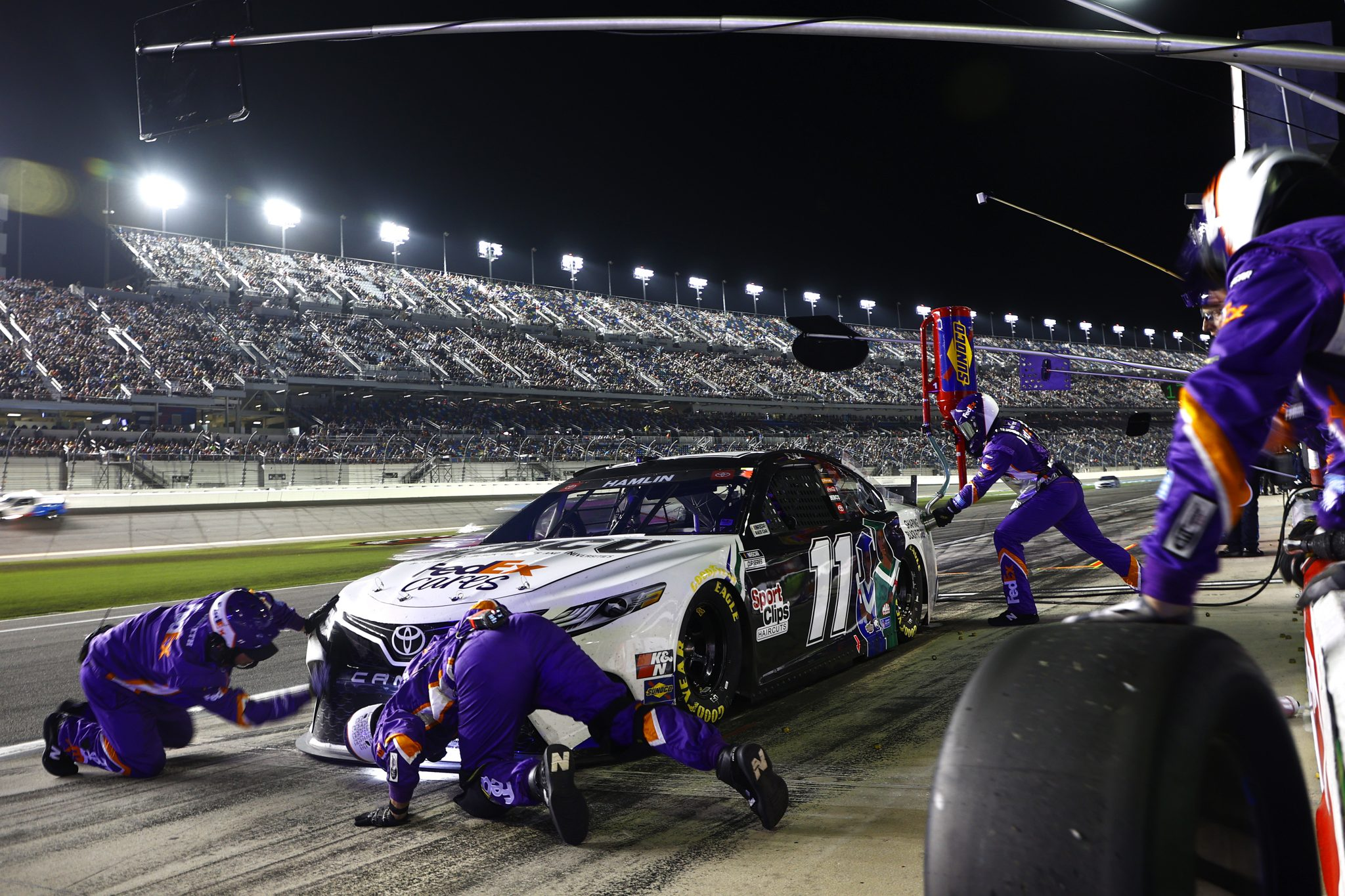 DAYTONA BEACH, FLORIDA - AUGUST 28: Denny Hamlin, driver of the #11 FedEx Shaping Black Futures Toyota, pits during the NASCAR Cup Series Coke Zero Sugar 400 at Daytona International Speedway on August 28, 2021 in Daytona Beach, Florida. (Photo by Jared C. Tilton/Getty Images)   Getty Images