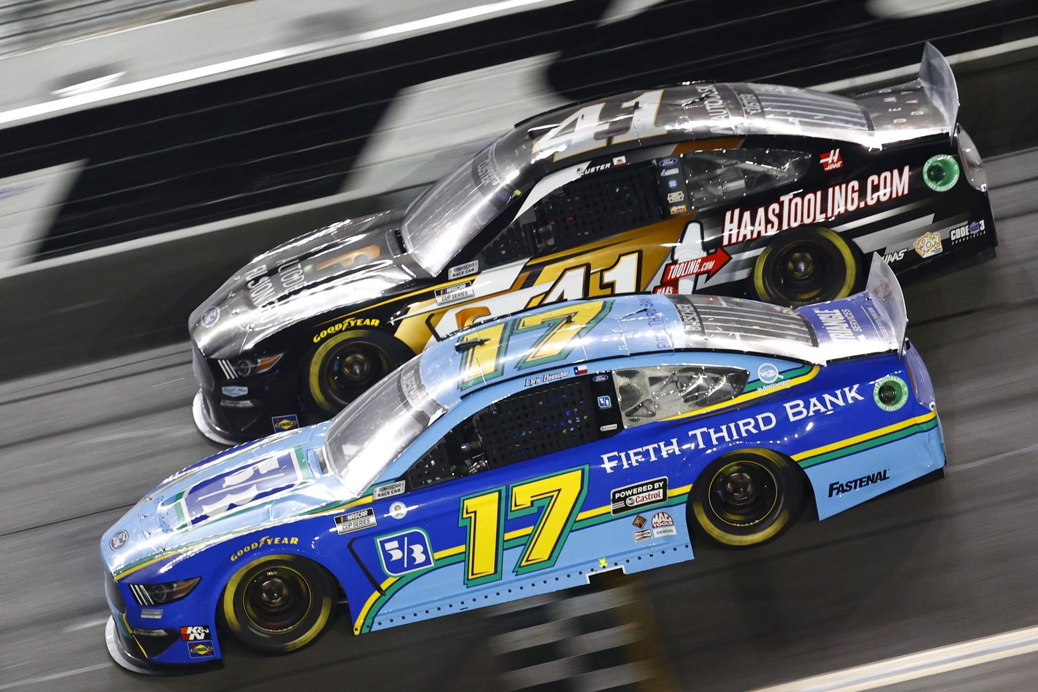 DAYTONA BEACH, FLORIDA - AUGUST 28: Chris Buescher, driver of the #17 Fifth Third Bank Ford, and Cole Custer, driver of the #41 Autodesk/HaasTooling.com Ford, race during the NASCAR Cup Series Coke Zero Sugar 400 at Daytona International Speedway on August 28, 2021 in Daytona Beach, Florida. (Photo by Jared C. Tilton/Getty Images) | Getty Images