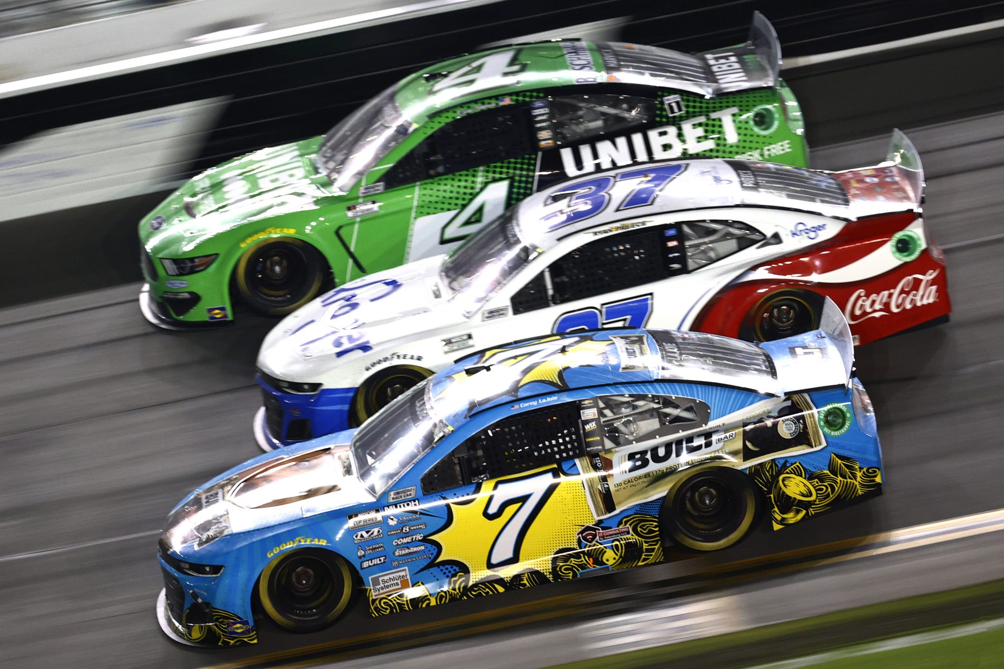 DAYTONA BEACH, FLORIDA - AUGUST 28: Corey LaJoie, driver of the #7 Built bar Chevrolet, Ryan Preece, driver of the #37 Kroger/Coca-Cola Chevrolet, and Kevin Harvick, driver of the #4 Unibet Ford, race during the NASCAR Cup Series Coke Zero Sugar 400 at Daytona International Speedway on August 28, 2021 in Daytona Beach, Florida. (Photo by Jared C. Tilton/Getty Images)   Getty Images
