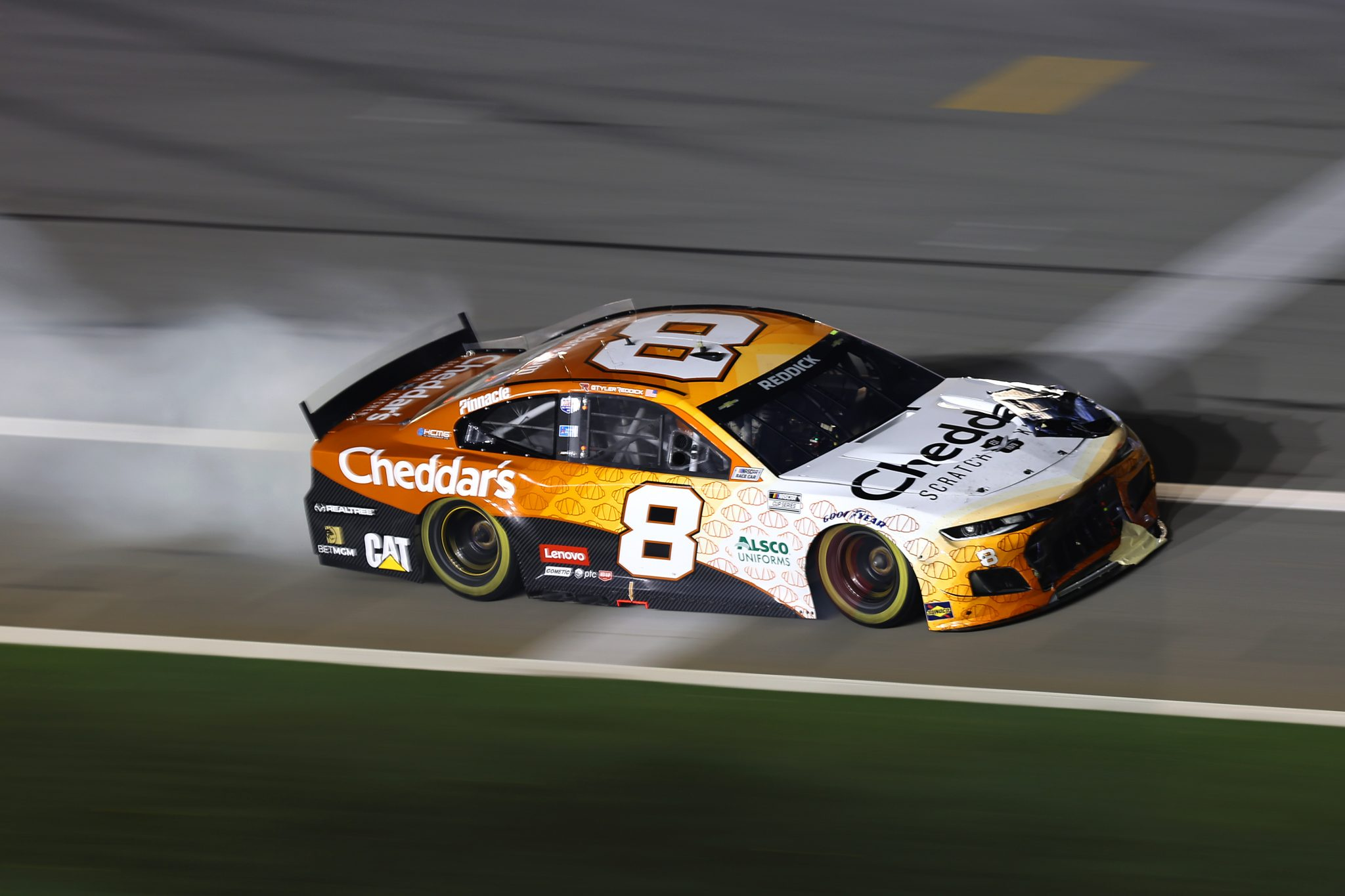 DAYTONA BEACH, FLORIDA - AUGUST 28: Tyler Reddick, driver of the #8 Cheddar's Scratch Kitchen Chevrolet, drives with a trail of smoke during the NASCAR Cup Series Coke Zero Sugar 400 at Daytona International Speedway on August 28, 2021 in Daytona Beach, Florida. (Photo by James Gilbert/Getty Images)   Getty Images