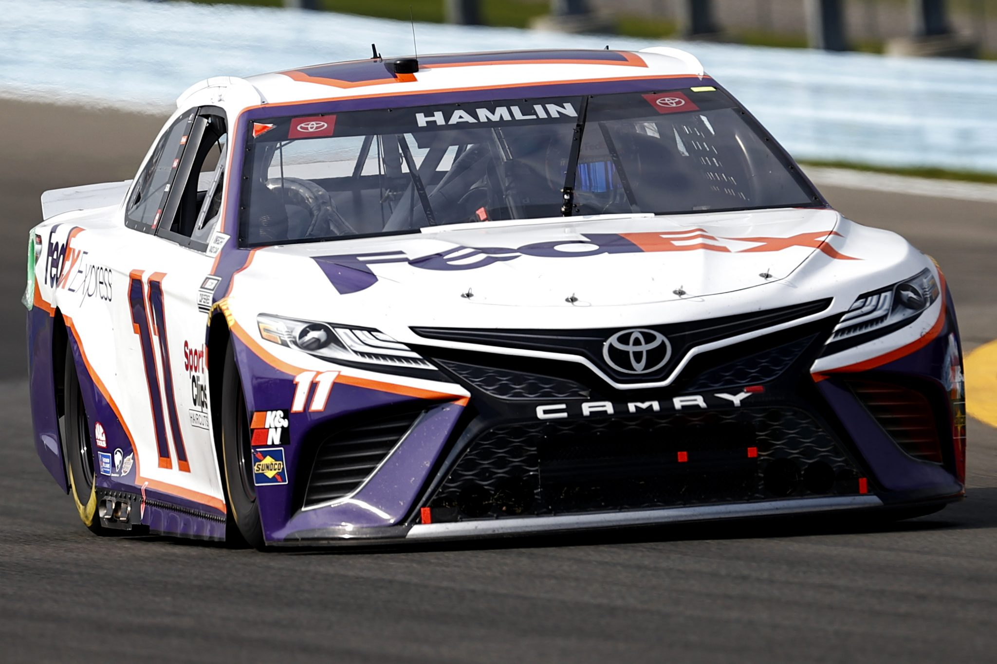 WATKINS GLEN, NEW YORK - AUGUST 08: Denny Hamlin, driver of the #11 FedEx Express Toyota, drives during the NASCAR Cup Series Go Bowling at The Glen at Watkins Glen International on August 08, 2021 in Watkins Glen, New York. (Photo by Jared C. Tilton/Getty Images)   Getty Images