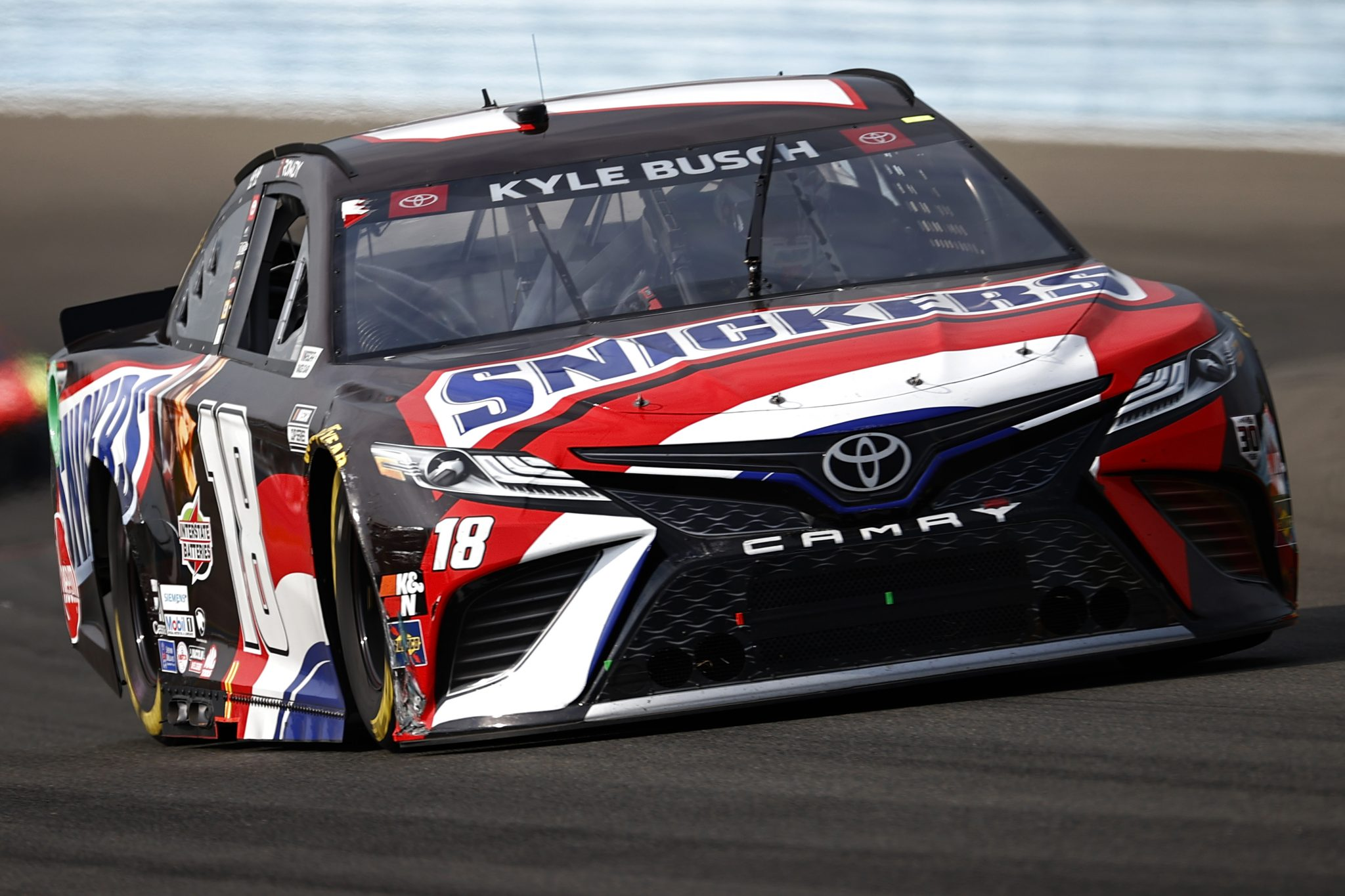 WATKINS GLEN, NEW YORK - AUGUST 08: Kyle Busch, driver of the #18 Snickers Toyota, drives during the NASCAR Cup Series Go Bowling at The Glen at Watkins Glen International on August 08, 2021 in Watkins Glen, New York. (Photo by Jared C. Tilton/Getty Images) | Getty Images