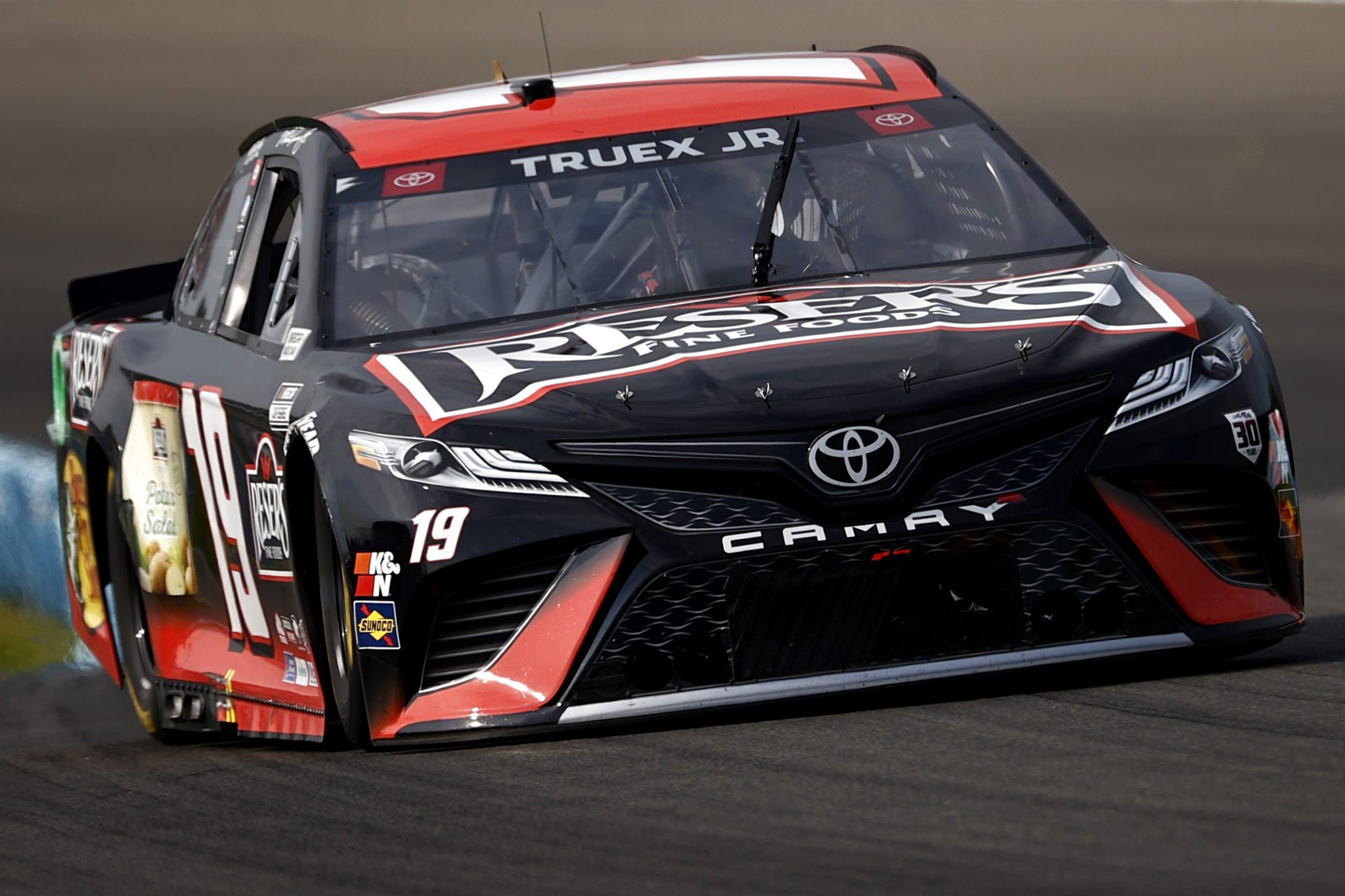 WATKINS GLEN, NEW YORK - AUGUST 08: Martin Truex Jr., driver of the #19 Reser's Fine Foods Toyota, drives during the NASCAR Cup Series Go Bowling at The Glen at Watkins Glen International on August 08, 2021 in Watkins Glen, New York. (Photo by Jared C. Tilton/Getty Images) | Getty Images