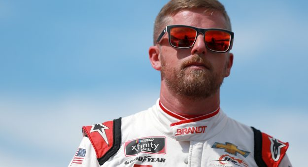 INDIANAPOLIS, INDIANA - AUGUST 14: Justin Allgaier, driver of the #7 BRANDT Chevrolet, waits on the grid prior to the NASCAR Xfinity Series Pennzoil 150 at the Brickyard at Indianapolis Motor Speedway on August 14, 2021 in Indianapolis, Indiana. (Photo by Sean Gardner/Getty Images) | Getty Images