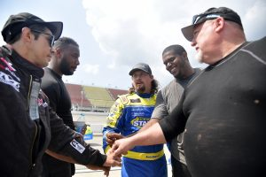 BROOKLYN, MICHIGAN - AUGUST 21: Josh Williams, driver of the #92 General Formulations Chevrolet, meets with his crew on the grid prior to the NASCAR Xfinity Series New Holland 250 at Michigan International Speedway on August 21, 2021 in Brooklyn, Michigan. (Photo by Logan Riely/Getty Images)   Getty Images