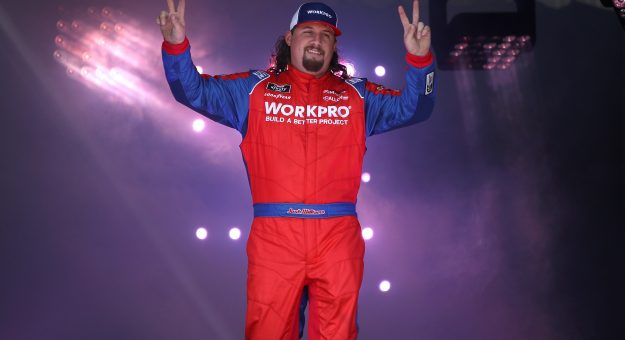 RICHMOND, VIRGINIA - SEPTEMBER 11: Josh Williams, driver of the #92 WORKPRO Tools Chevrolet, walks on stage during pre-race ceremonies prior to the NASCAR Xfinity Series Go Bowling 250 at Richmond Raceway on September 11, 2021 in Richmond, Virginia. (Photo by Sean Gardner/Getty Images)   Getty Images