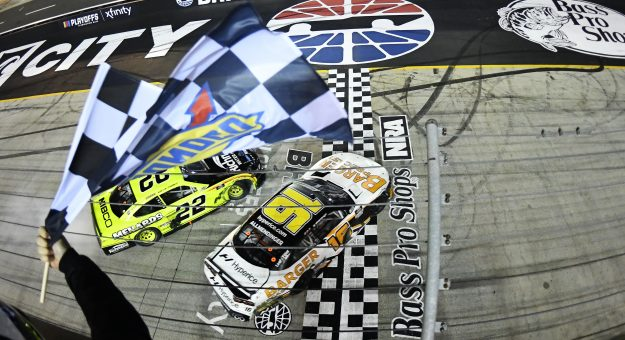 BRISTOL, TENNESSEE - SEPTEMBER 17: AJ Allmendinger, driver of the #16 Barger Precast Chevrolet, spins across the finish line after an incident with Austin Cindric, driver of the #22 Menards/Richmond Ford, to win the NASCAR Xfinity Series Food City 300 at Bristol Motor Speedway on September 17, 2021 in Bristol, Tennessee. (Photo by Logan Riely/Getty Images) | Getty Images