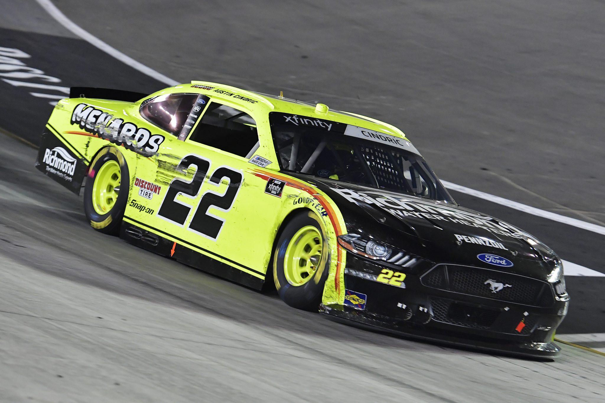 BRISTOL, TENNESSEE - SEPTEMBER 17: Austin Cindric, driver of the #22 Menards/Richmond Ford,drives during the NASCAR Xfinity Series Food City 300 at Bristol Motor Speedway on September 17, 2021 in Bristol, Tennessee. (Photo by Logan Riely/Getty Images) | Getty Images