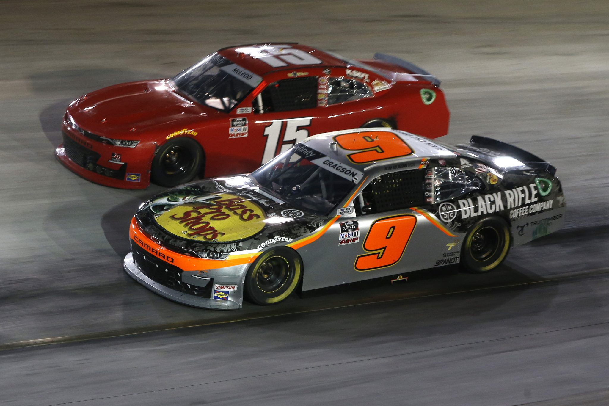 BRISTOL, TENNESSEE - SEPTEMBER 17: Noah Gragson, driver of the #9 Bass Pro Shops/TrueTimber/BRCC Chevrolet, and BJ McLeod, driver of the #15 TeamJDMotorsports.com Chevrolet, race during the NASCAR Xfinity Series Food City 300 at Bristol Motor Speedway on September 17, 2021 in Bristol, Tennessee. (Photo by Brian Lawdermilk/Getty Images) | Getty Images