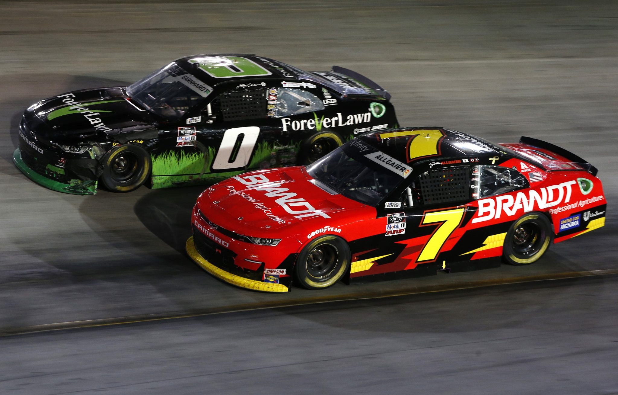 BRISTOL, TENNESSEE - SEPTEMBER 17: Jeffrey Earnhardt, driver of the #0 ForeverLawn Chevrolet, and Justin Allgaier, driver of the #7 BRANDT Chevrolet, race during the NASCAR Xfinity Series Food City 300 at Bristol Motor Speedway on September 17, 2021 in Bristol, Tennessee. (Photo by Brian Lawdermilk/Getty Images) | Getty Images