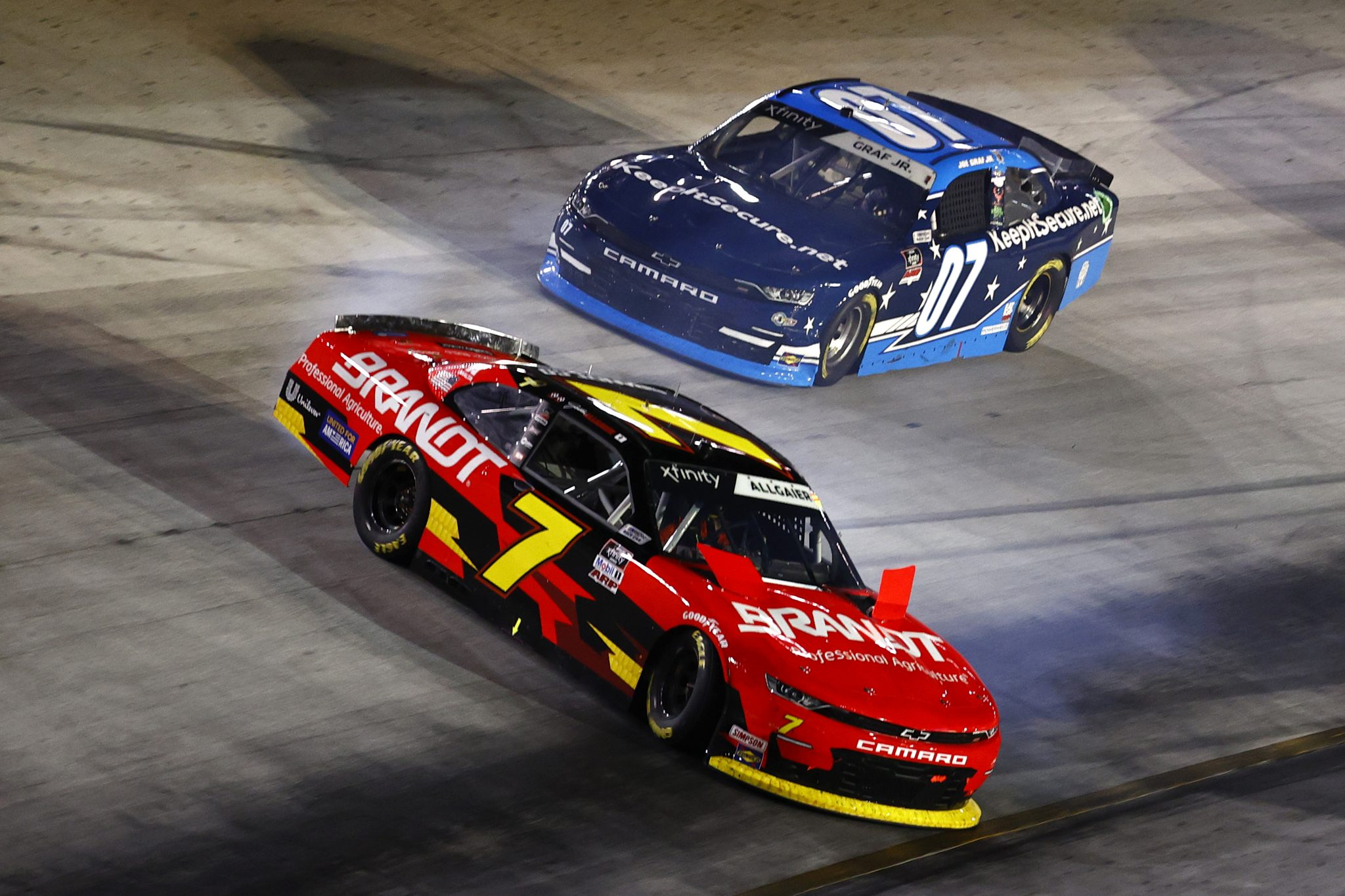 BRISTOL, TENNESSEE - SEPTEMBER 17: Justin Allgaier, driver of the #7 BRANDT Chevrolet, spins in front of Joe Graf Jr., driver of the #07 KeepItSecure.net Chevrolet, during the NASCAR Xfinity Series Food City 300 at Bristol Motor Speedway on September 17, 2021 in Bristol, Tennessee. (Photo by Jared C. Tilton/Getty Images) | Getty Images