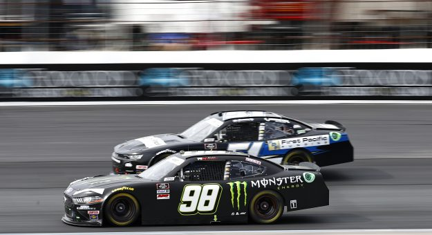 LOUDON, NEW HAMPSHIRE - JULY 17: Riley Herbst, driver of the #98 Monster Energy Ford, and Jeremy Clements, driver of the #51 First Pacific Funding Chevrolet, race during the NASCAR Xfinity Series Ambetter Get Vaccinated 200 at New Hampshire Motor Speedway on July 17, 2021 in Loudon, New Hampshire. (Photo by Jared C. Tilton/Getty Images) | Getty Images
