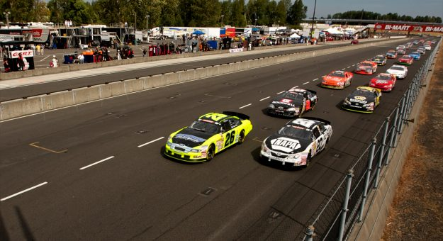 PORTLAND, OR - AUGUST 26: Greg Pursley, driver of the #26 GPM/Star Nursery/Real Water Ford leads a pack of cars at the start of the NASCAR K&N Pro Series West Napa Auto Parts Salute to the Troops 125 on August 26, 2012 at Portland International Raceway in Portland, Oregon.  (Photo by Craig Mitchelldyer/Getty Images for NASCAR)   Getty Images