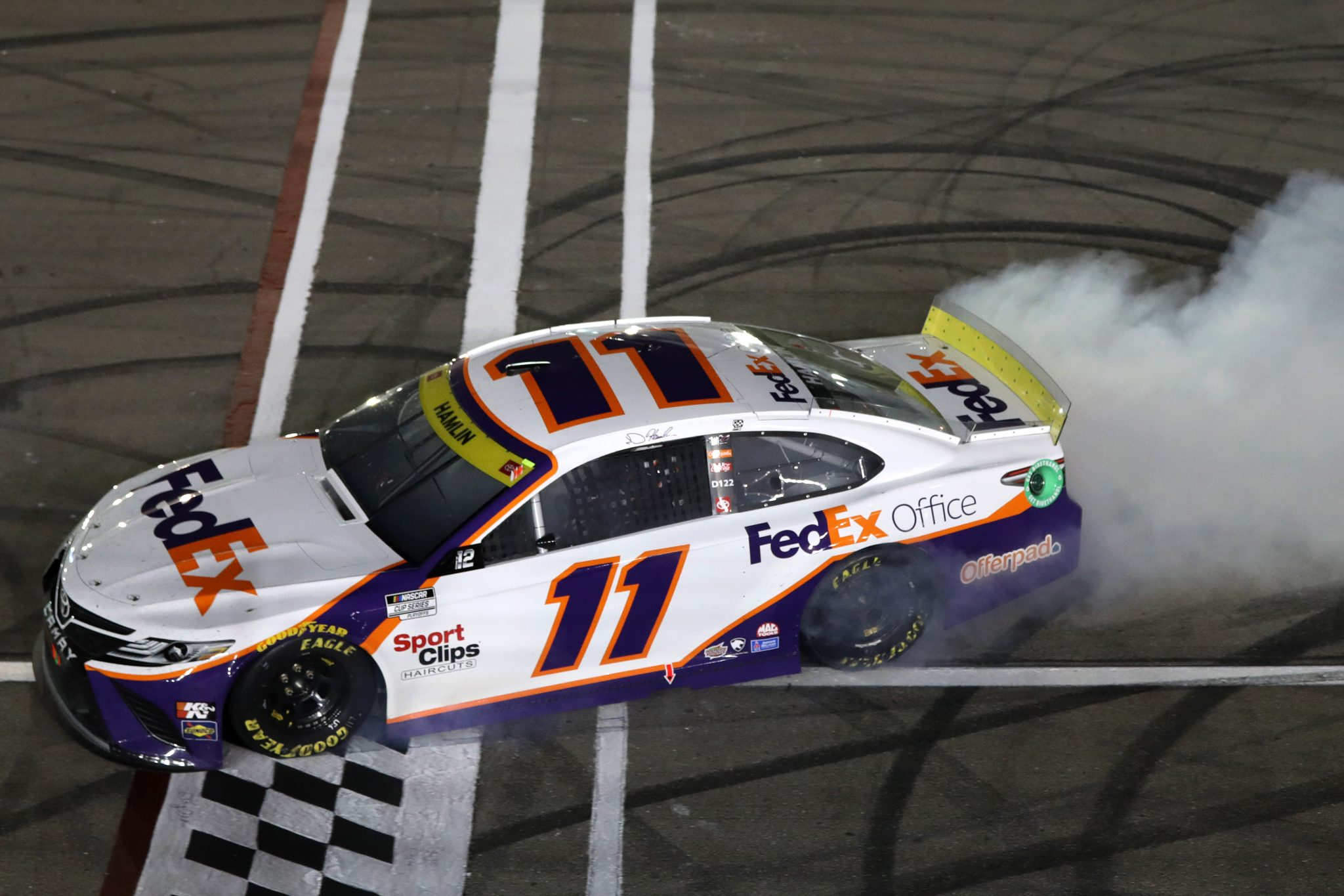 LAS VEGAS, NEVADA - SEPTEMBER 26: Denny Hamlin, driver of the #11 FedEx Office Toyota, celebrates with a burnout after winning the NASCAR Cup Series South Point 400 at Las Vegas Motor Speedway on September 26, 2021 in Las Vegas, Nevada. (Photo by Meg Oliphant/Getty Images)   Getty Images