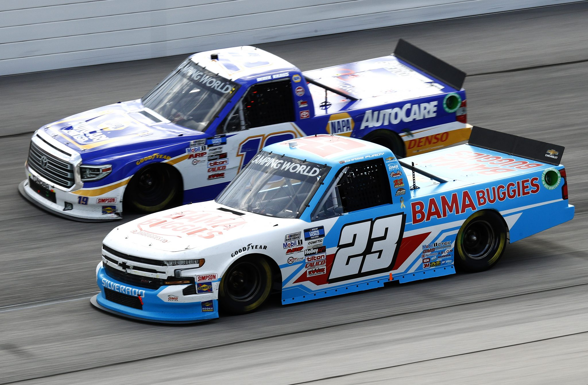 DARLINGTON, SOUTH CAROLINA - SEPTEMBER 05: Chase Purdy, driver of the #23 BamaBuggies.com Chevrolet, and Derek Kraus, driver of the #19 NAPA AutoCare Toyota, race during the NASCAR Camping World Truck Series In It To Win It 200 at Darlington Raceway on September 05, 2021 in Darlington, South Carolina. (Photo by Jared East/Getty Images)   Getty Images