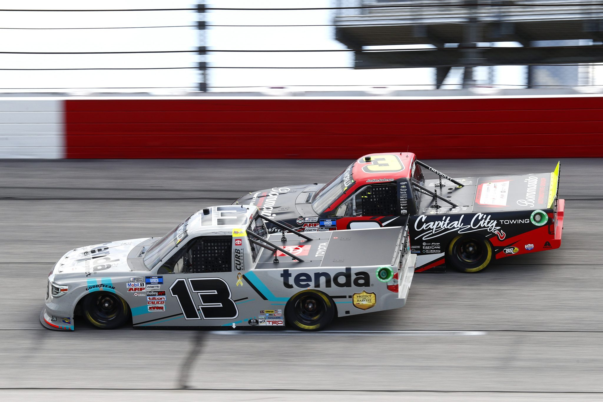 DARLINGTON, SOUTH CAROLINA - SEPTEMBER 05: Johnny Sauter, driver of the #13 Tenda Equine & Pet Care Products Toyota, and Jordan Anderson, driver of the #3 Bommarito.com/Capital City Towing Chevrolet, race during the NASCAR Camping World Truck Series In It To Win It 200 at Darlington Raceway on September 05, 2021 in Darlington, South Carolina. (Photo by Jared East/Getty Images)   Getty Images