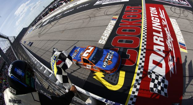 DARLINGTON, SOUTH CAROLINA - SEPTEMBER 05: Sheldon Creed, driver of the #2 Liftkits4less.com Chevrolet, takes the checkered flag to win the NASCAR Camping World Truck Series In It To Win It 200 at Darlington Raceway on September 05, 2021 in Darlington, South Carolina. (Photo by Jared C. Tilton/Getty Images) | Getty Images